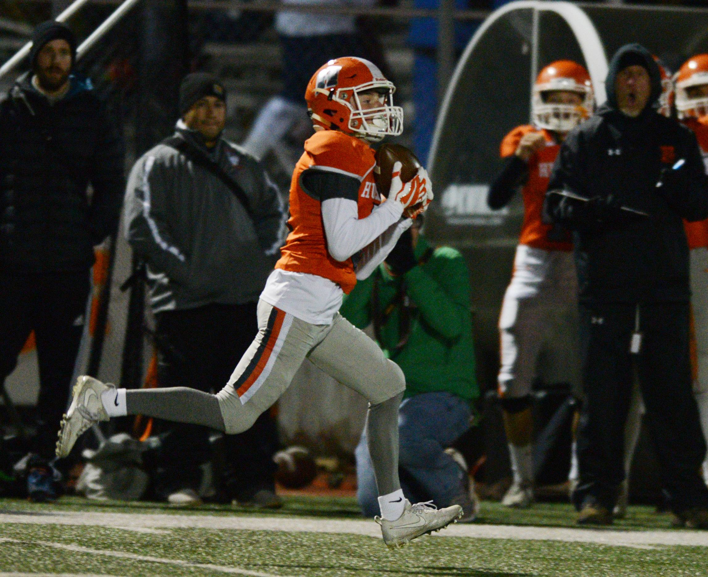 Hersey's Ian Ziegenhorn finishes a 96-yard touchdown catch in the third quarter during Class 7A first-round playoff action against Rolling Meadows in Arlington Heights on Friday.