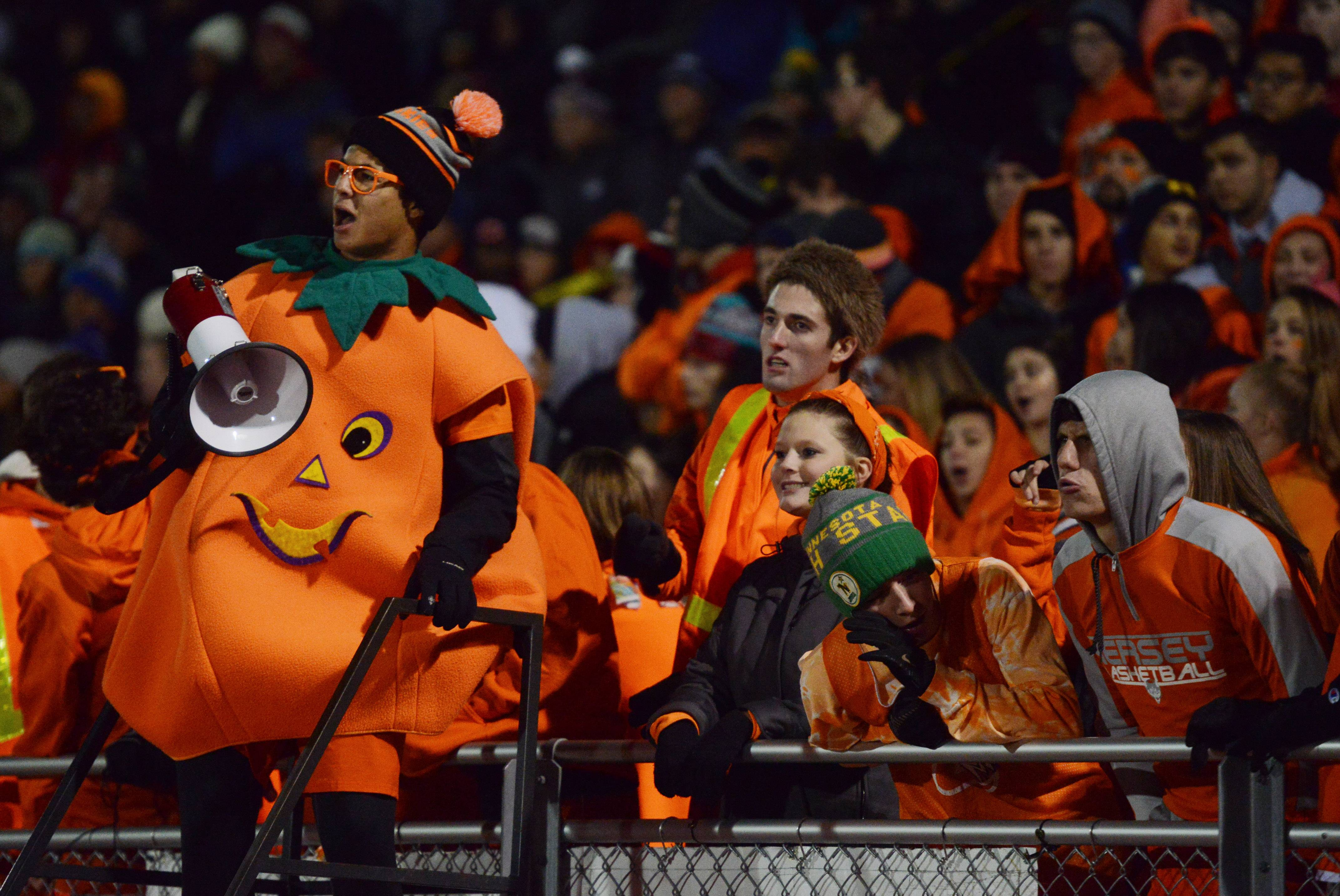 Hersey spirit leader Cristian Rodriguez, a senior, cheers for the Huskies during Class 7A first-round playoff action against Rolling Meadows in Arlington Heights on Friday.