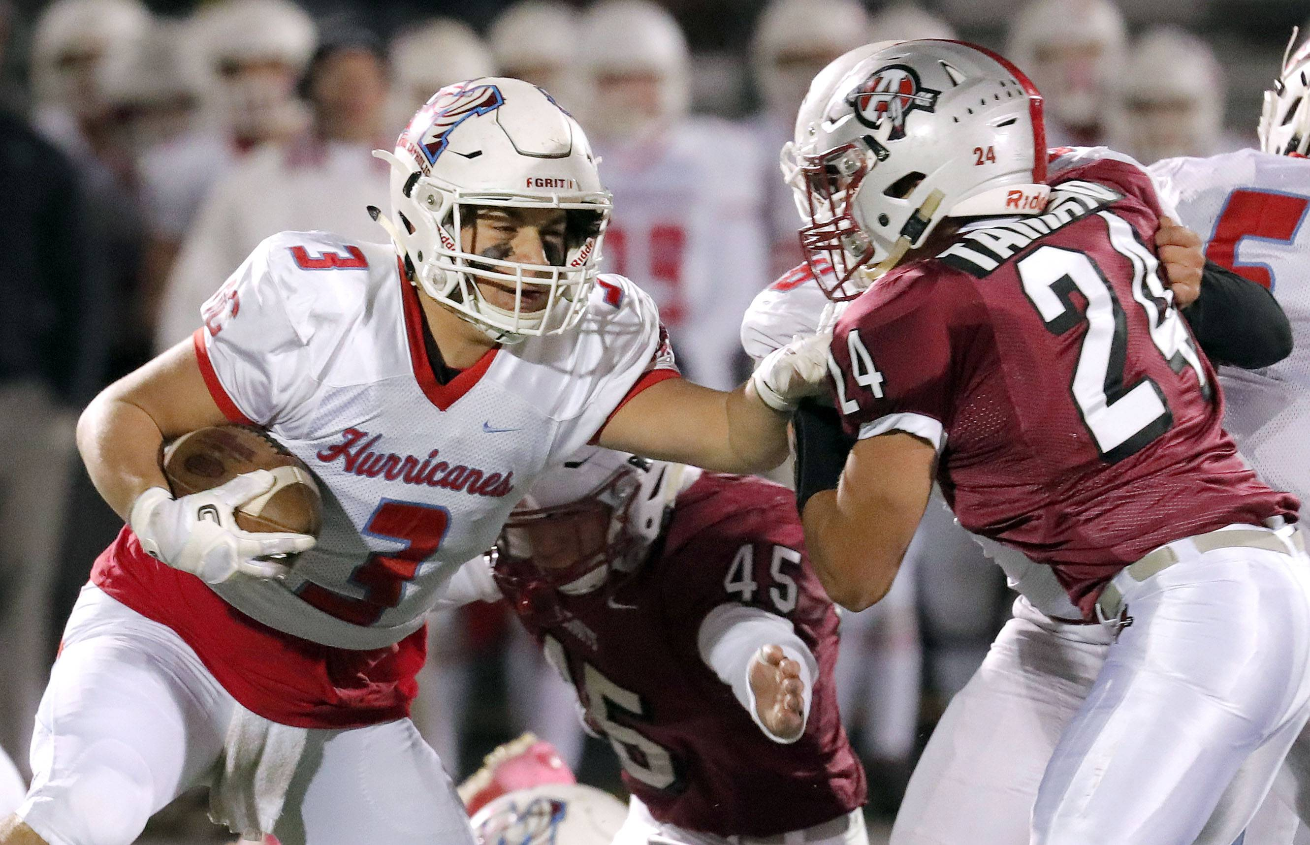 Marian Central's Pasquale Ricciardi (3) tries to get around Kevin Tamayo during Class 5A first-round playoff action Friday in Antioch.