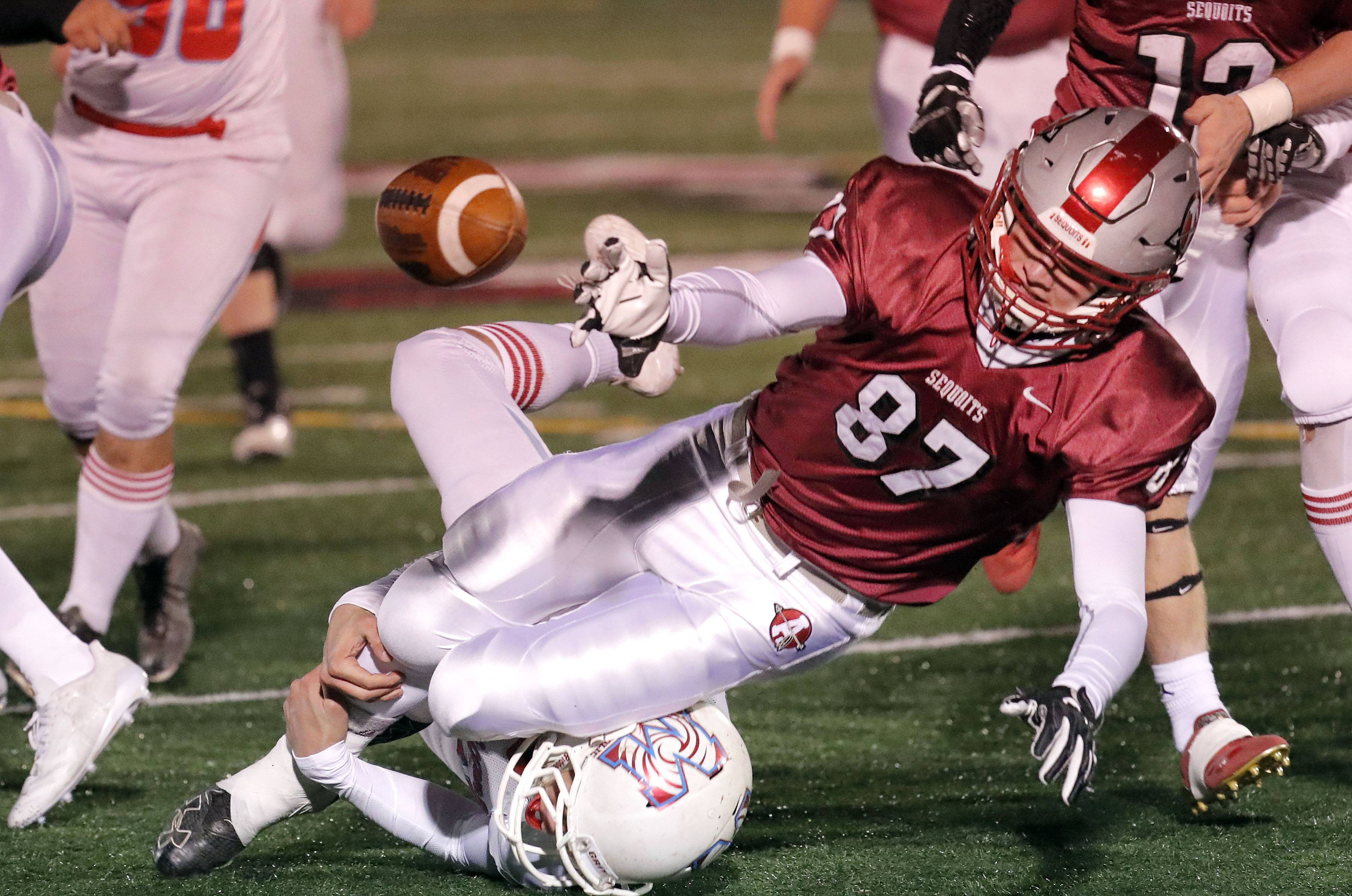 Antioch's Benjamin Nauman (87) fumbles against Marian Central during Class 5A first-round playoff action Friday in Antioch.