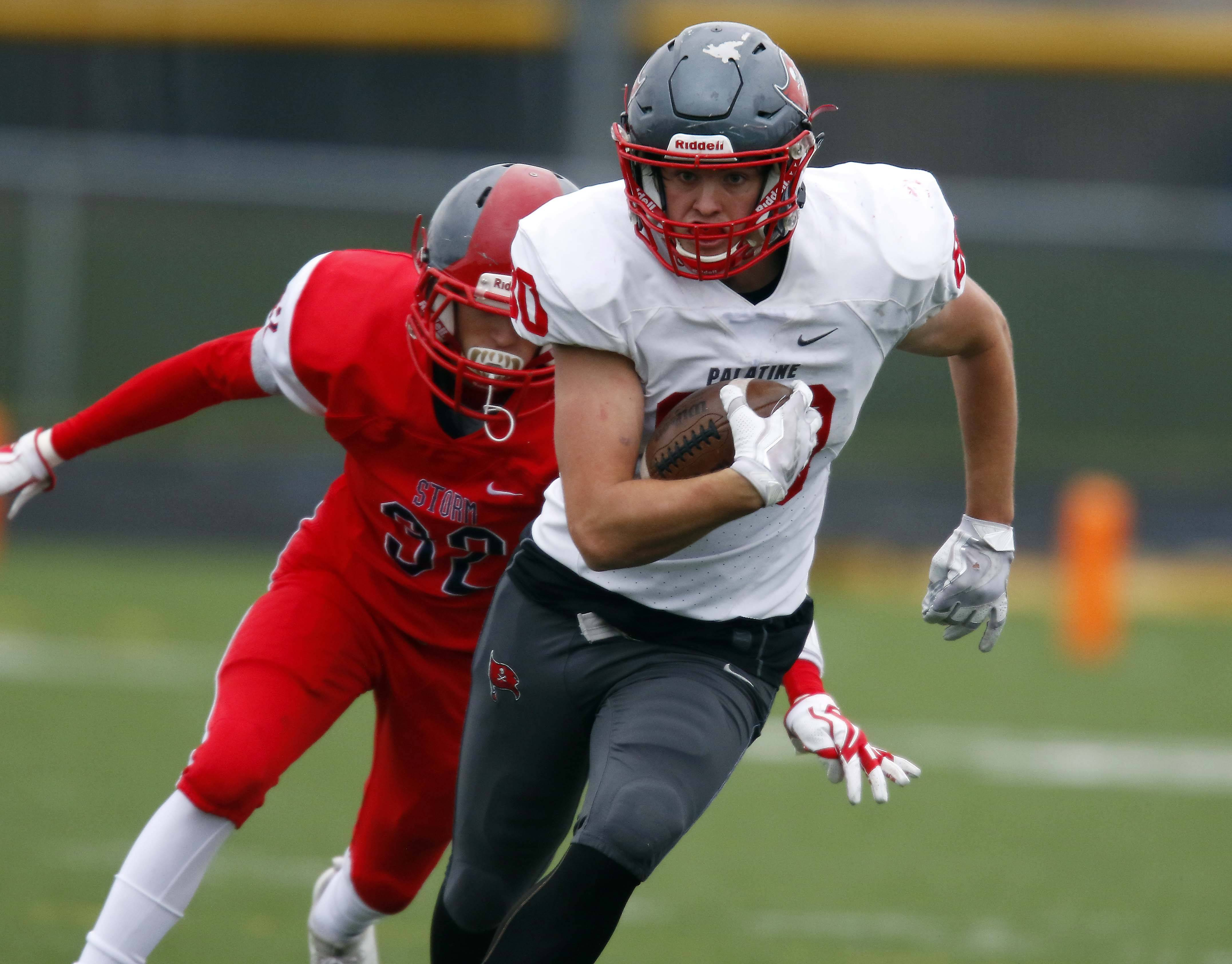 Palatine's Johnny O'Shea (80) moves upfield Saturday against South Elgin during the Pirates' 24-3 Class 8A football playoff wins at Millennium Field in Streamwood.