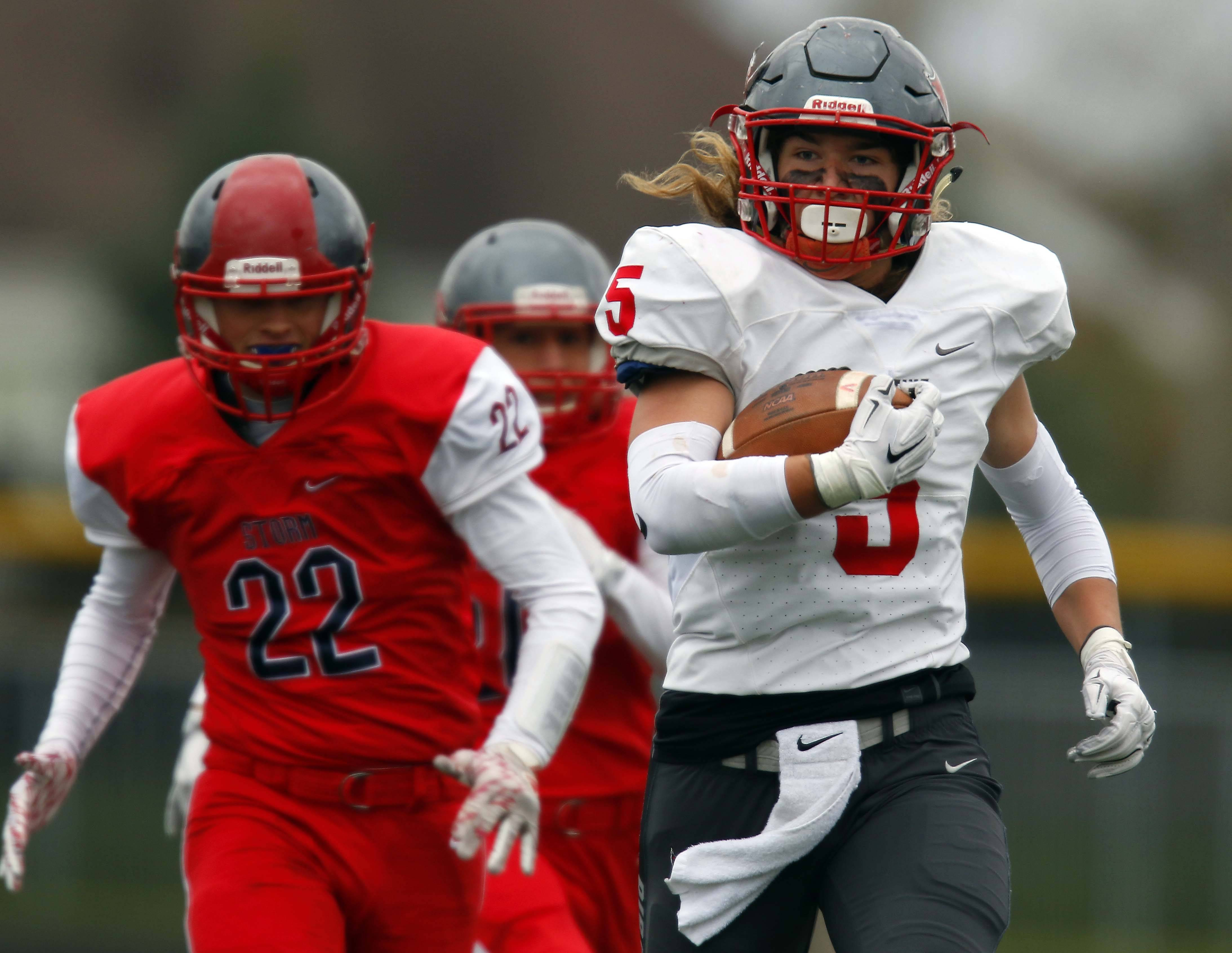 Palatine's Charlie Canty (5) moves up field Saturday during Palatine vs. South Elgin Class 8A football playoffs at Millennium Field in Streamwood.