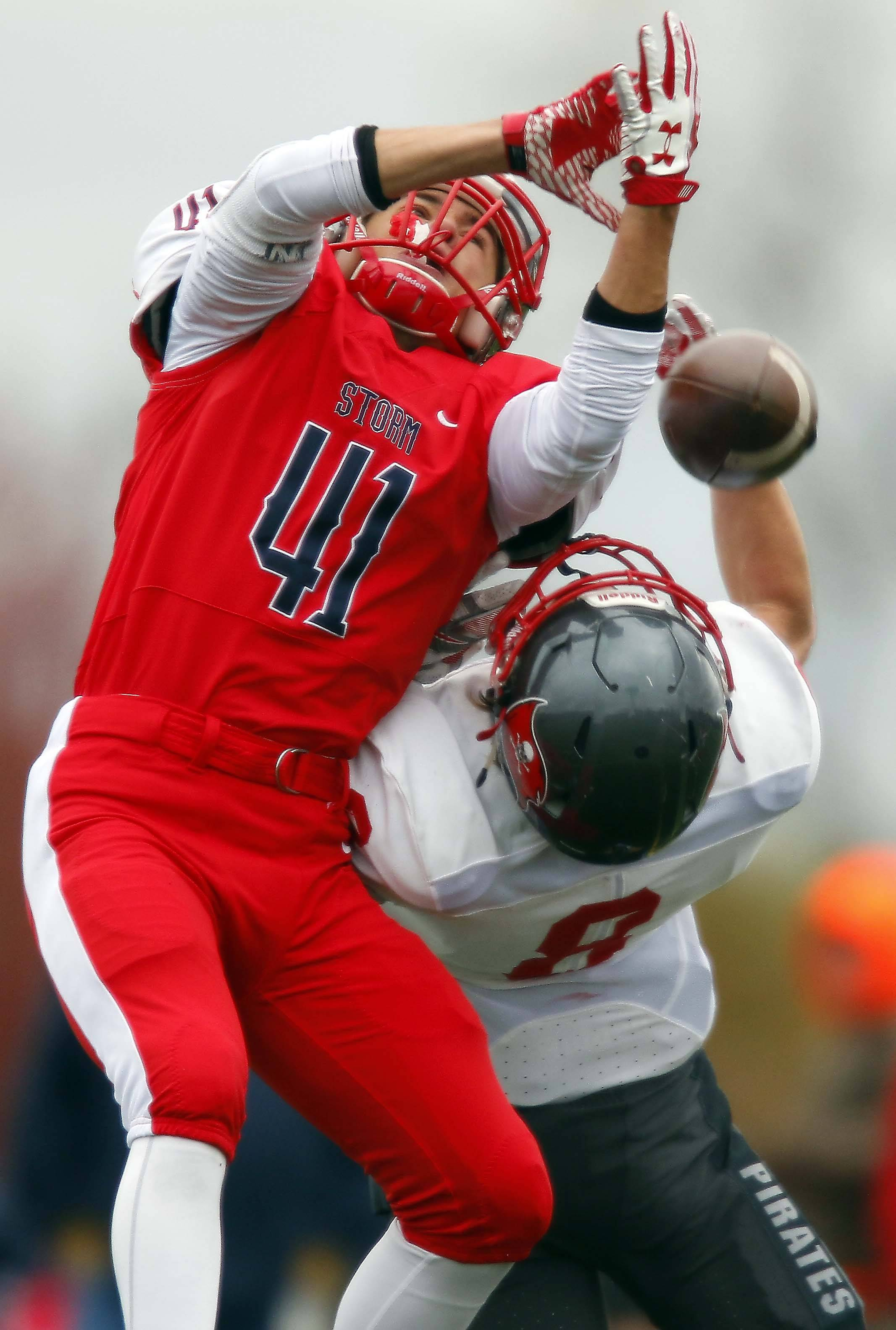 Palatine's Luis Bueso (41) and South Elgin's Nate Gomez (8) can't come down with the ball Saturday during Palatine vs. South Elgin Class 8A football playoffs at Millennium Field in Streamwood.