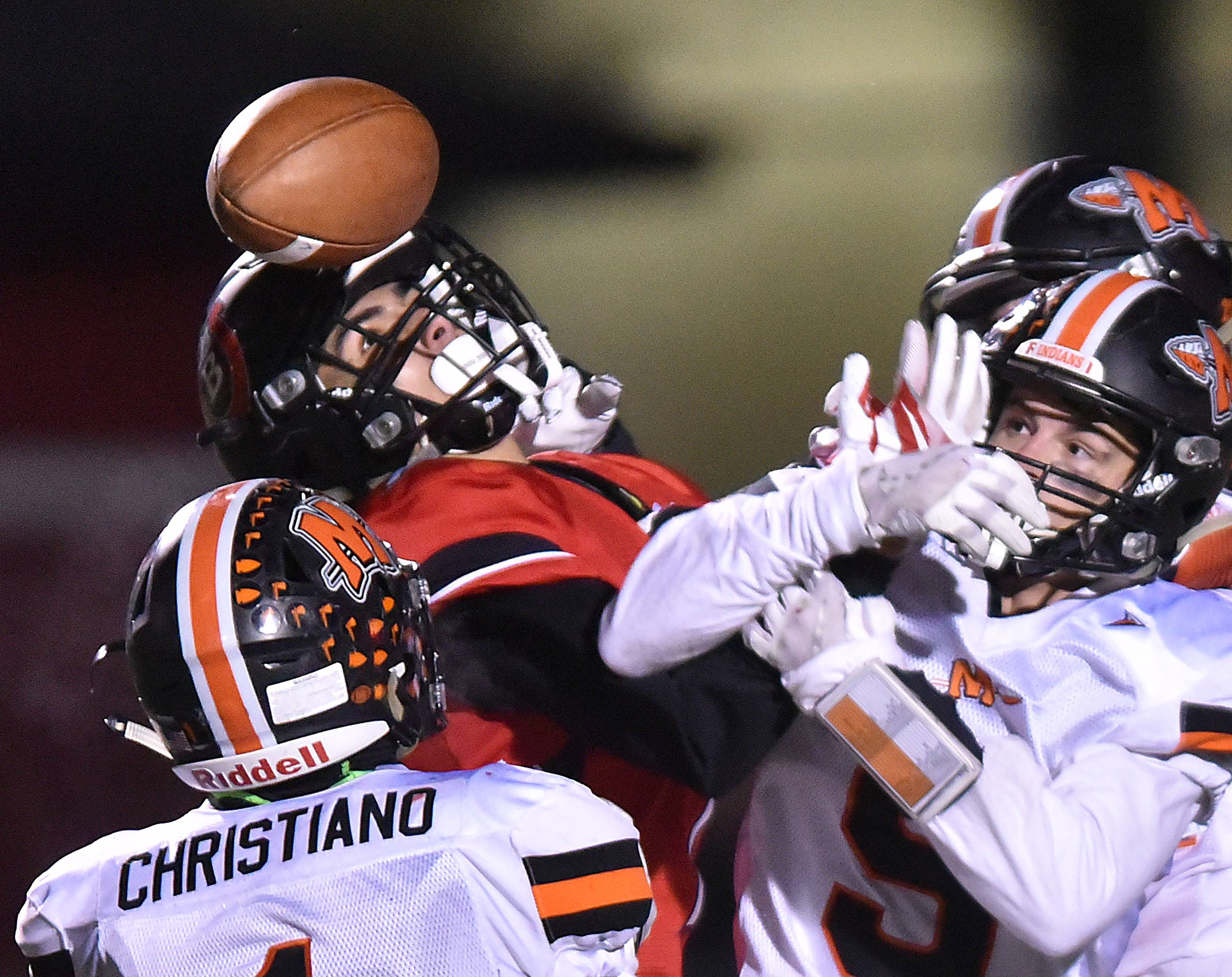 Barrington's Alec Andrea tries to secure a Hail Mary pass to the end zone with no time remaining in regulation and the score tied against visiting Minooka on Friday in the Class 8A football playoffs.
