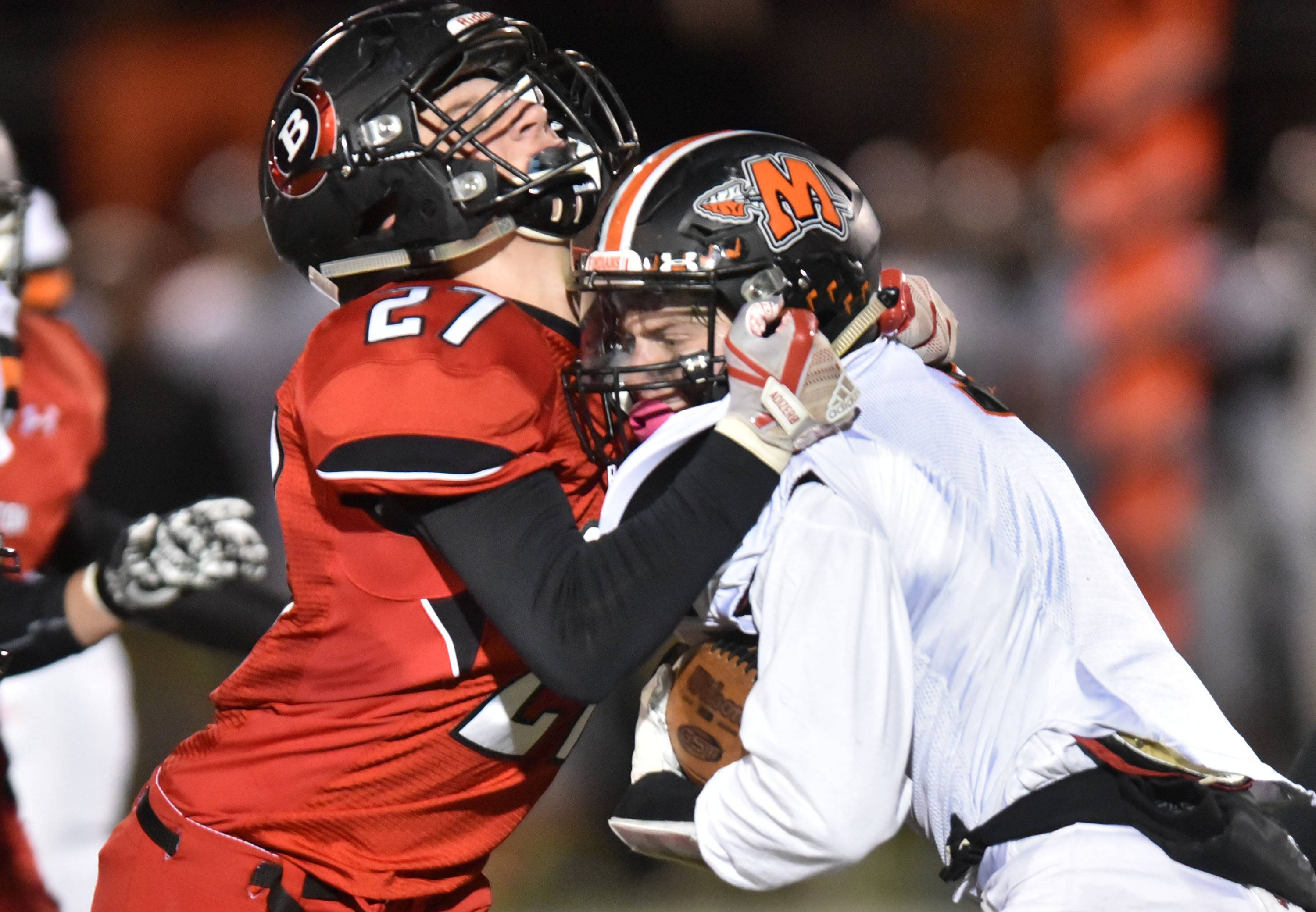 Barrington's Nick Bogaerts stops Minooka's Max Christiano in the first half Friday in the Class 8A football playoffs in Barrington.
