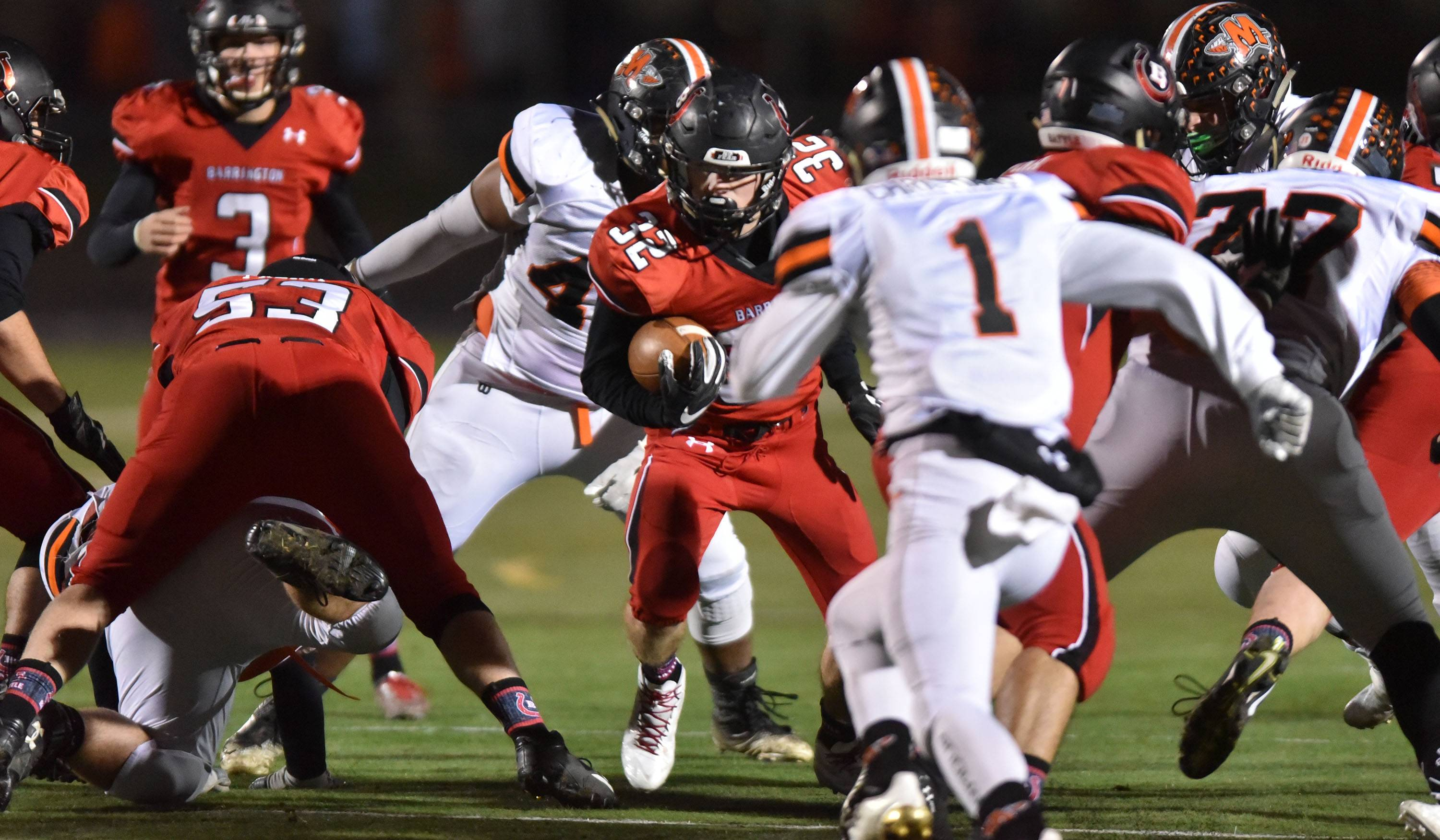 Barrington's Michael Curran carries for first-half yardage against visiting Minooka in the Class 8A playoffs Friday.
