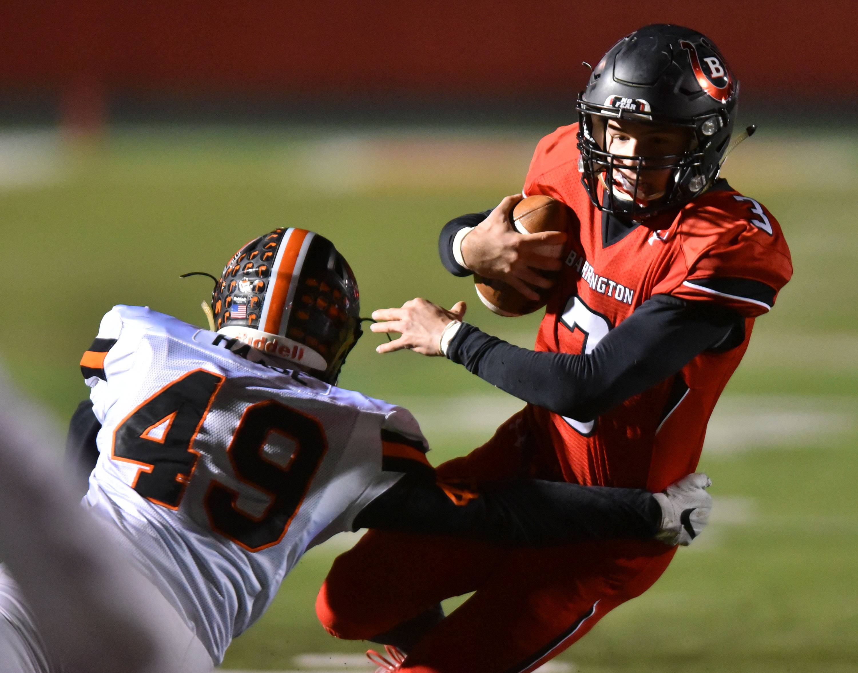 Barrington's Ray Niro tries to get around Minooka's Tyler Haase in the Class 8A playoff Friday at Barrington.
