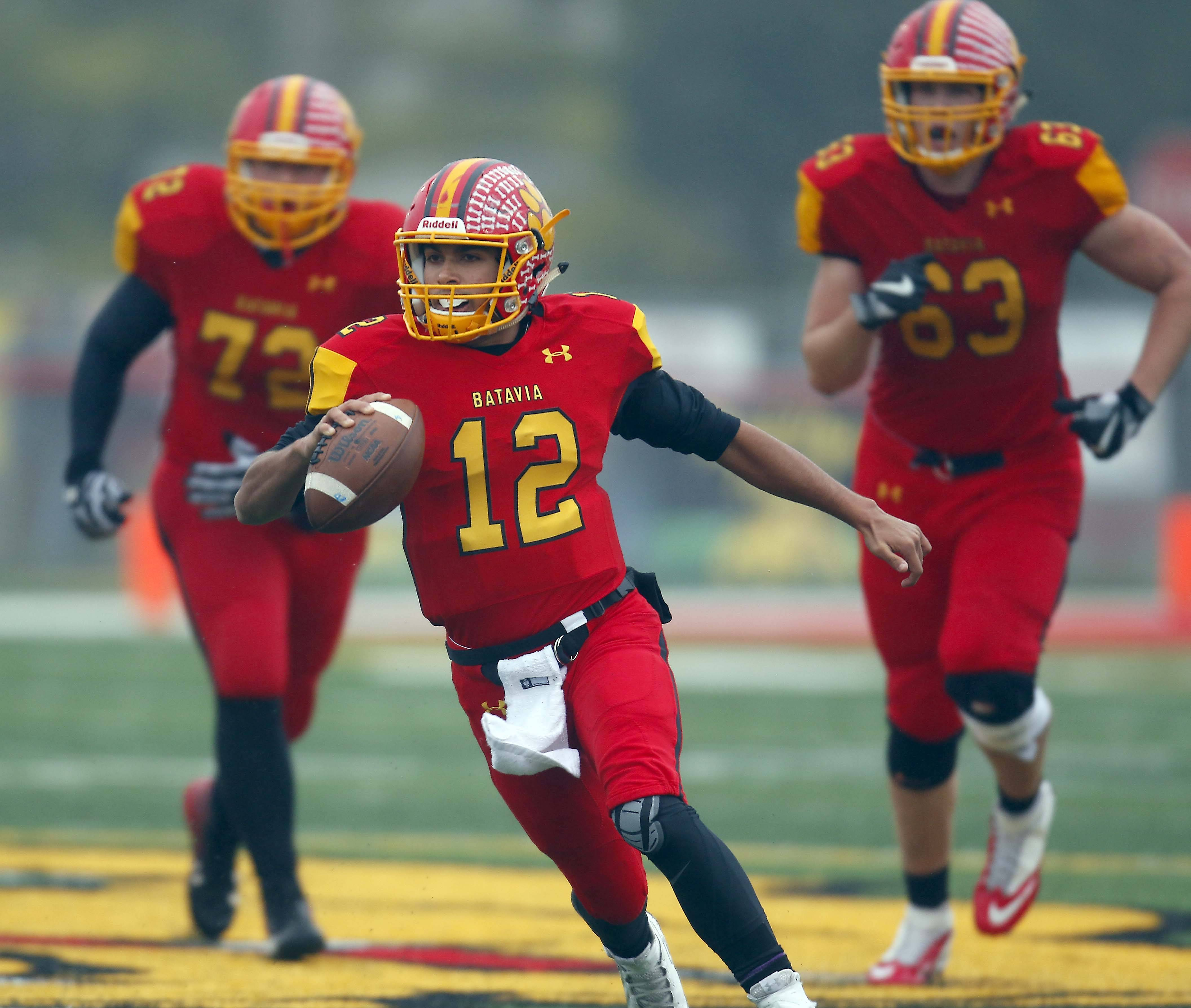 Batavia's Riley Cooper (12) moves upfield for more running room Saturday during the IHSA Class 7A football playoffs in Batavia.