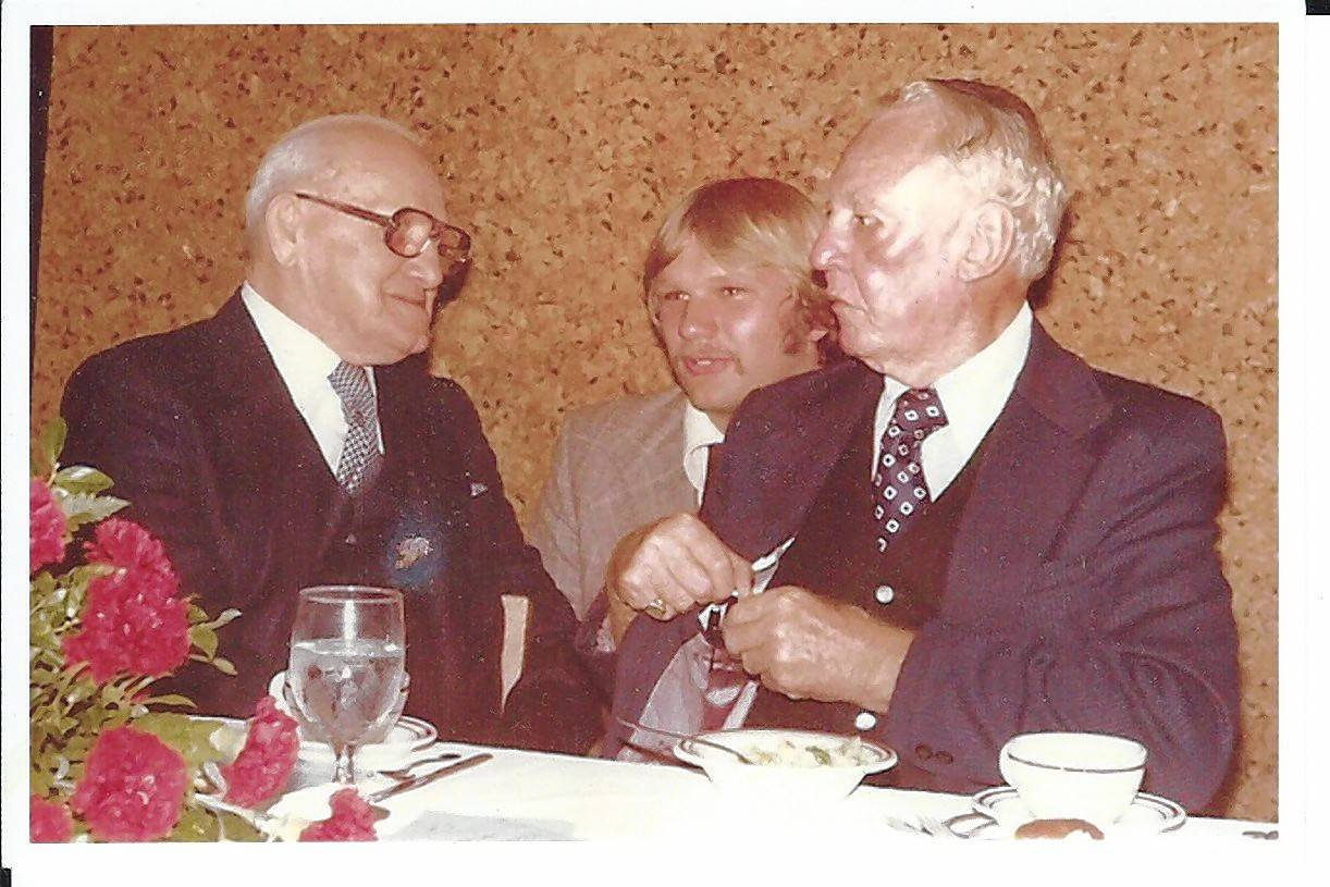 George Halas, left, talks with Keith Burlingame and Red Grange, right, at a reception at Wheaton College in 1974.