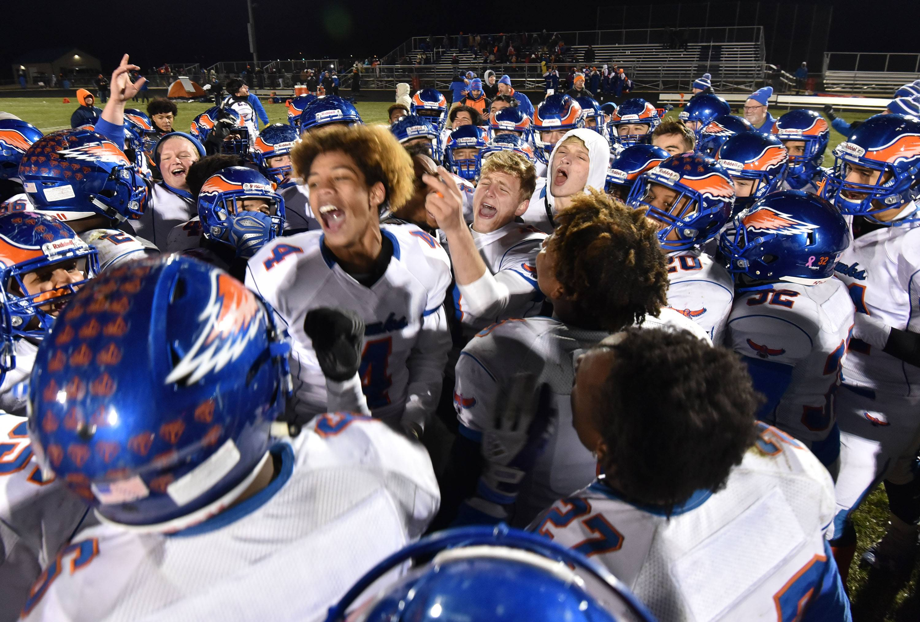 Hoffman Estates quarterback Austin Coalson points as he celebrates with teammates after the Hawks topped host Belvidere North 35-10 on Saturday in the Class 6A state quarterfinals.