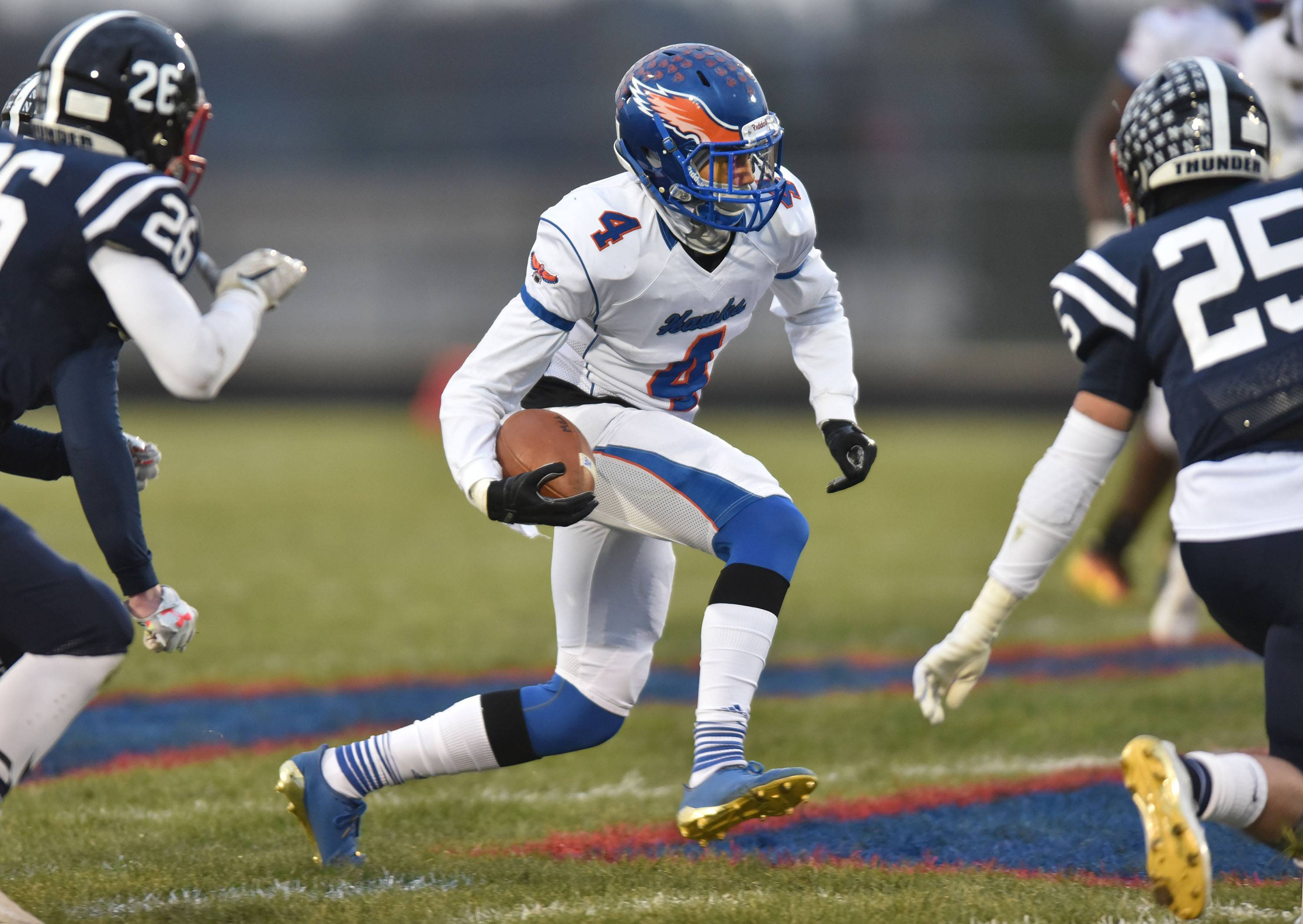 Hoffman Estates' Jayvon Blissett makes a move as he carries the ball against Belvidere North on Saturday in Class 6A state quarterfinal action in Belvidere.