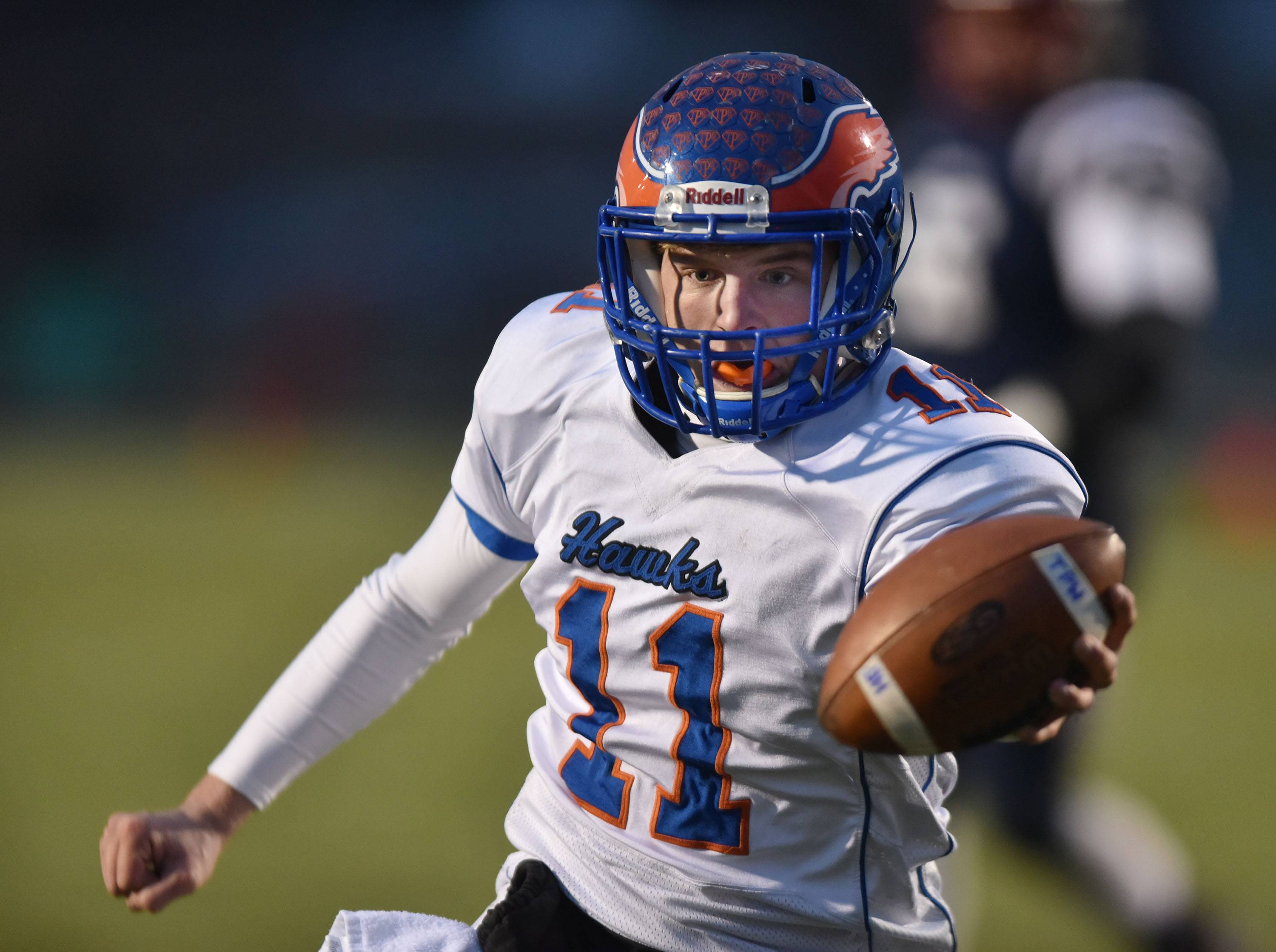 Hoffman Estates quarterback Austin Coalson reaches the ball over the goal line for a first-half touchdown against host Belvidere North on Saturday in the Class 6A state quarterfinals.