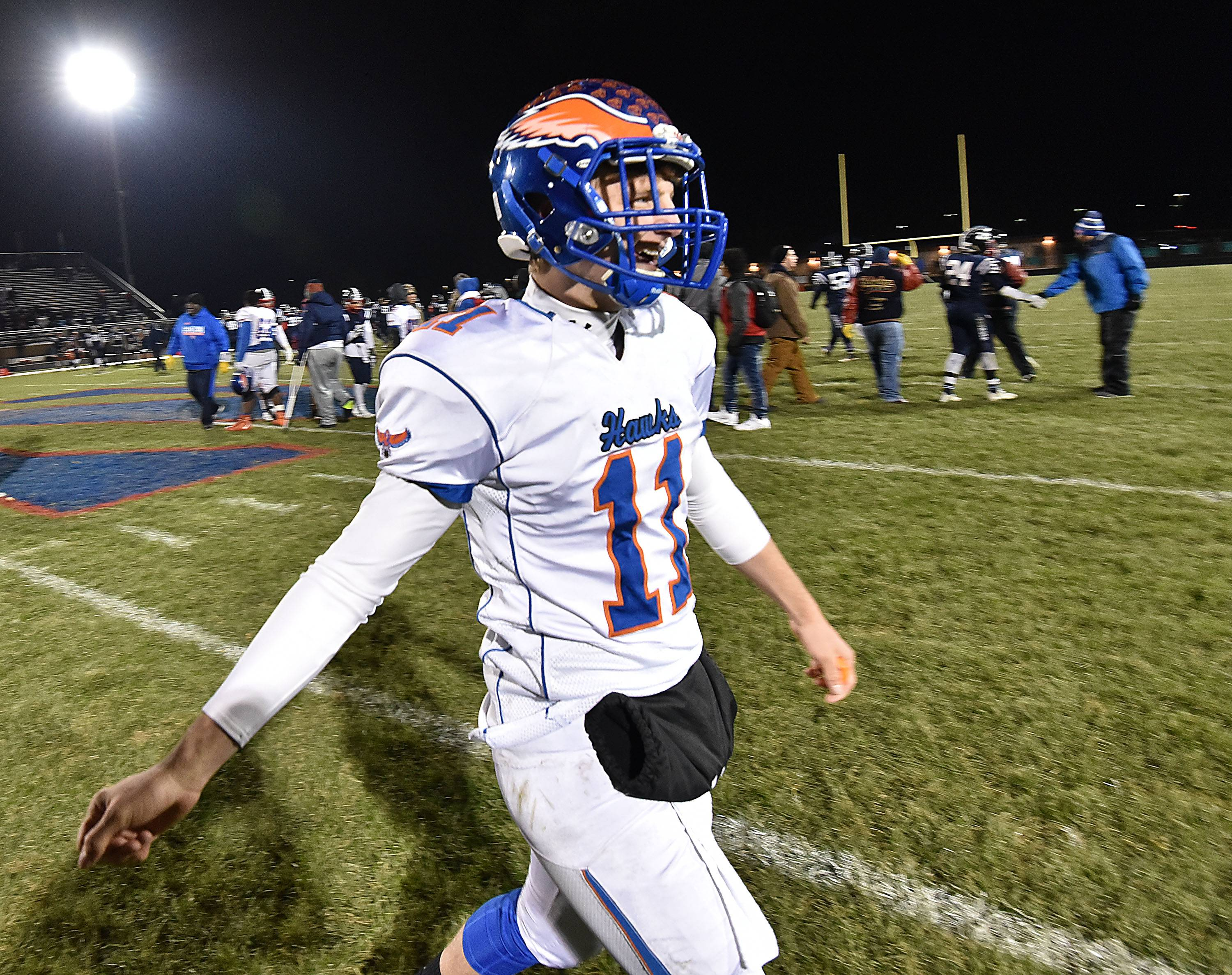 Hoffman Estates quarterback Austin Coalson celebrates the Hawks win against Belvidere North on Saturday in the Class 6A state quarterfinals.