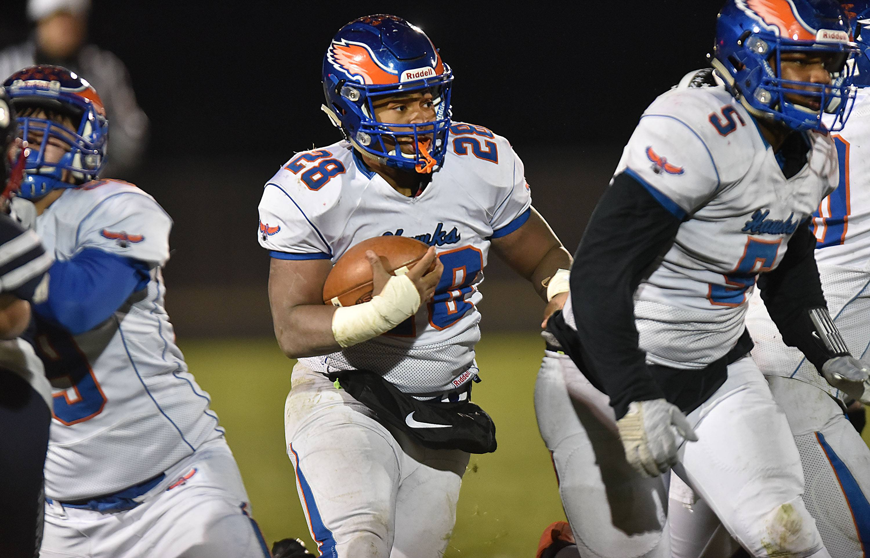 Hoffman Estates' Jaylin Johnson rumbles for second-half yardage against host Belvidere North Saturday in the Class 6A state quarterfinals.