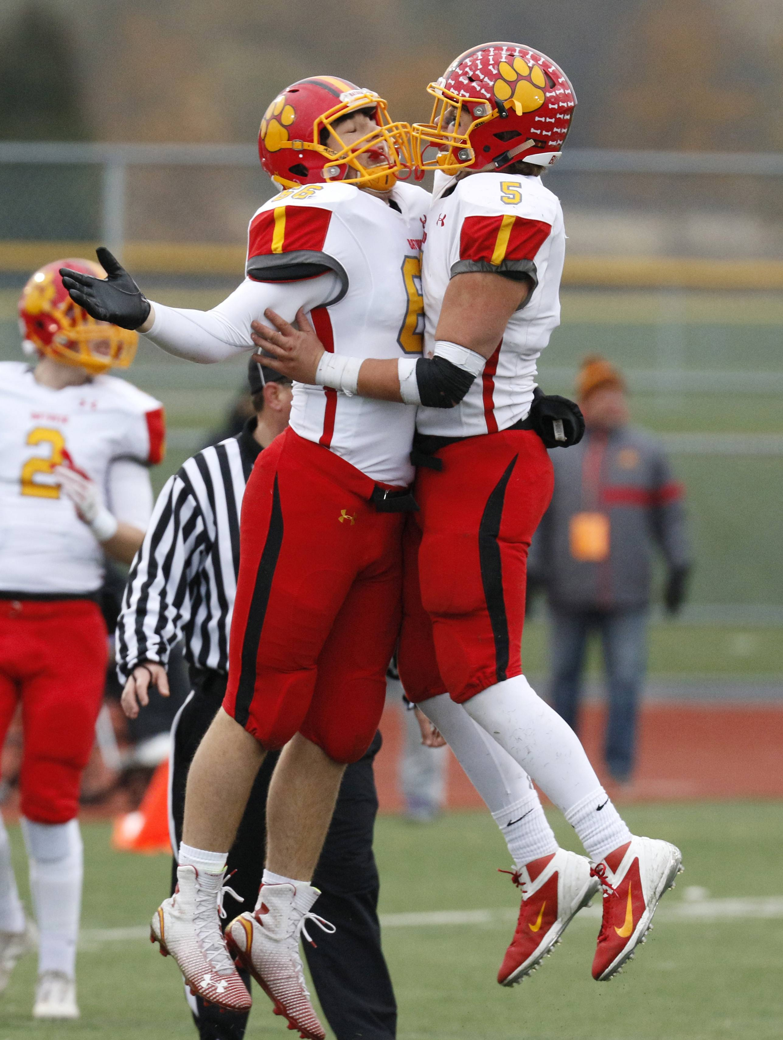 Batavia's Anthony Glisson, left, celebrates with Luke Weerts (5) after his team recovered a second half fumble against Lincoln-Way West during Class 7A football quarterfinal action in New Lenox.