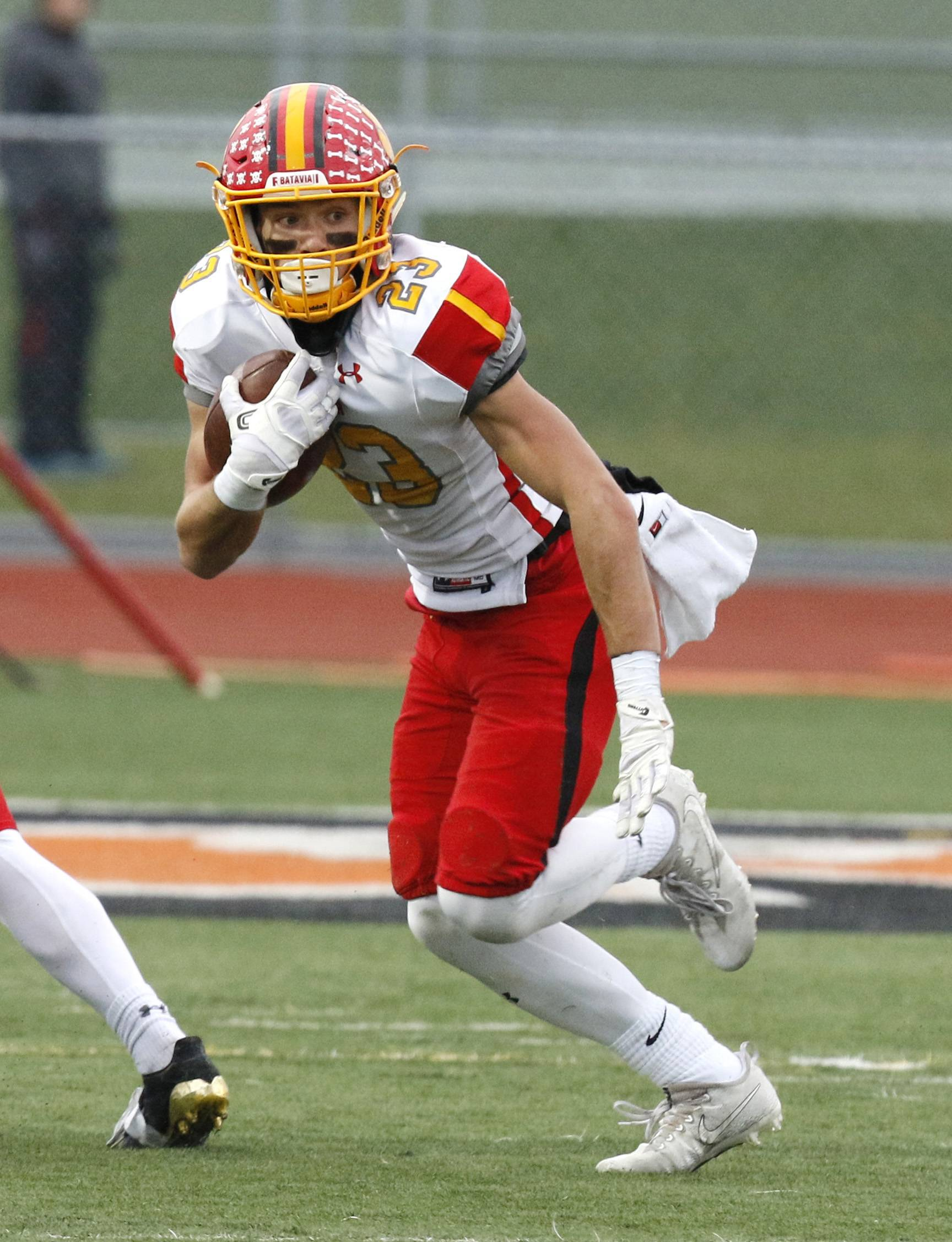 Batavia's Tommy Stuttle (23) looks for running room after his third interception of the game against Lincoln-Way West during a 20-10 win.