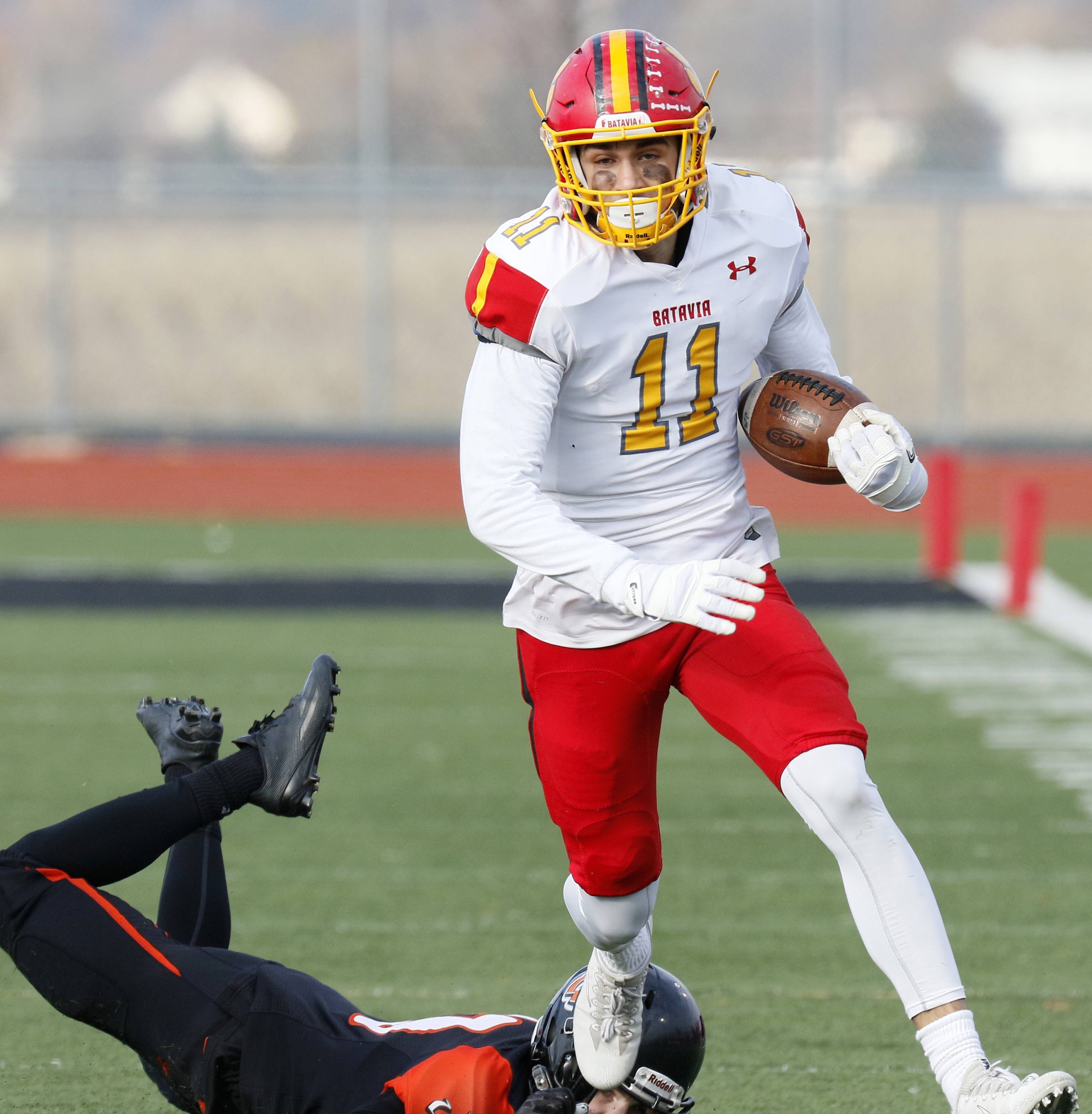 Batavia's Eric Peterson (11) scores the first of his two touchdowns during a 20-10 win over Lincoln-Way West.