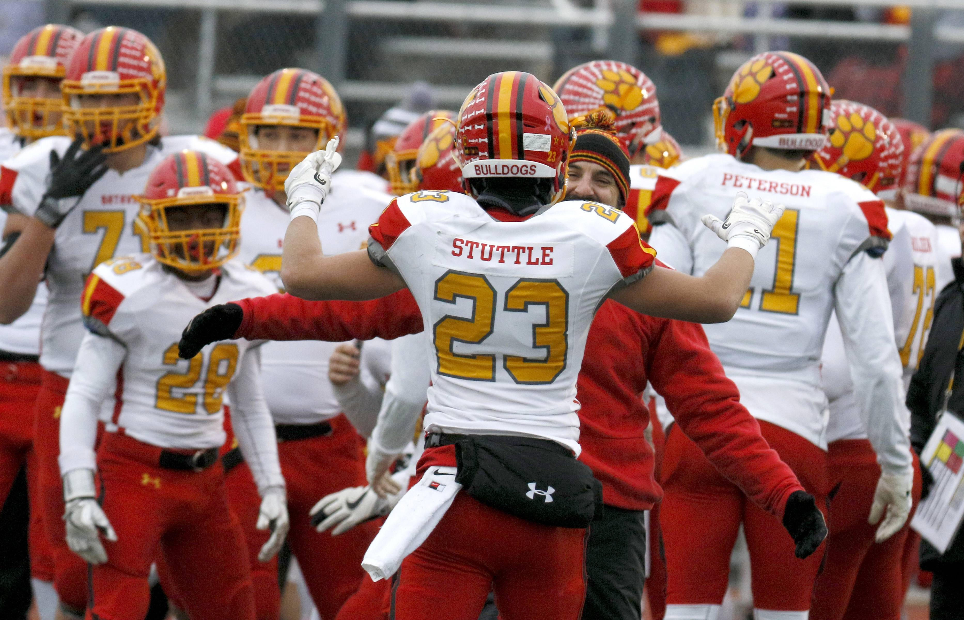 Batavia's Tommy Stuttle (23) returns to the bench after a second half interception against Lincoln-Way West during Class 7A football quarterfinal action in New Lenox.
