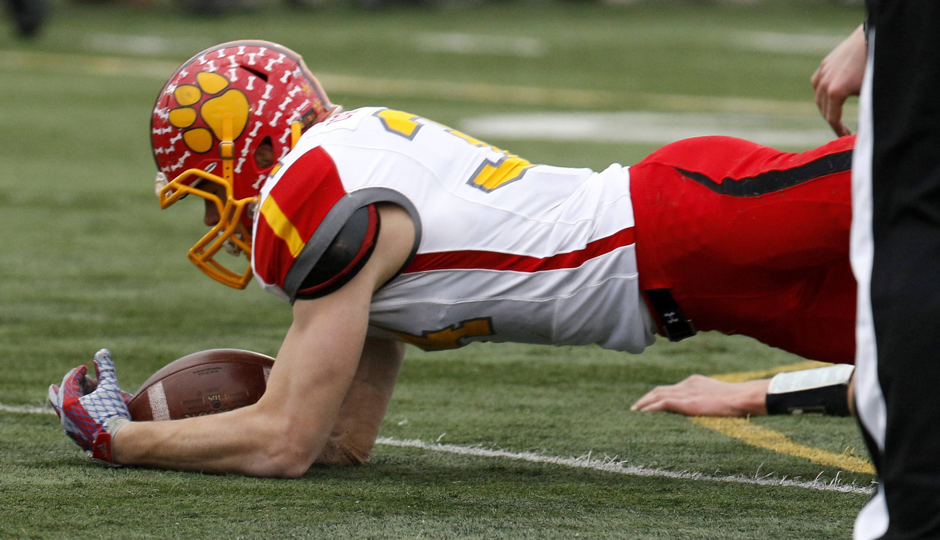 Batavia's Quin Urwiler recovers a second half fumble against Lincoln-Way West during Class 7A football quarterfinal action in New Lenox.