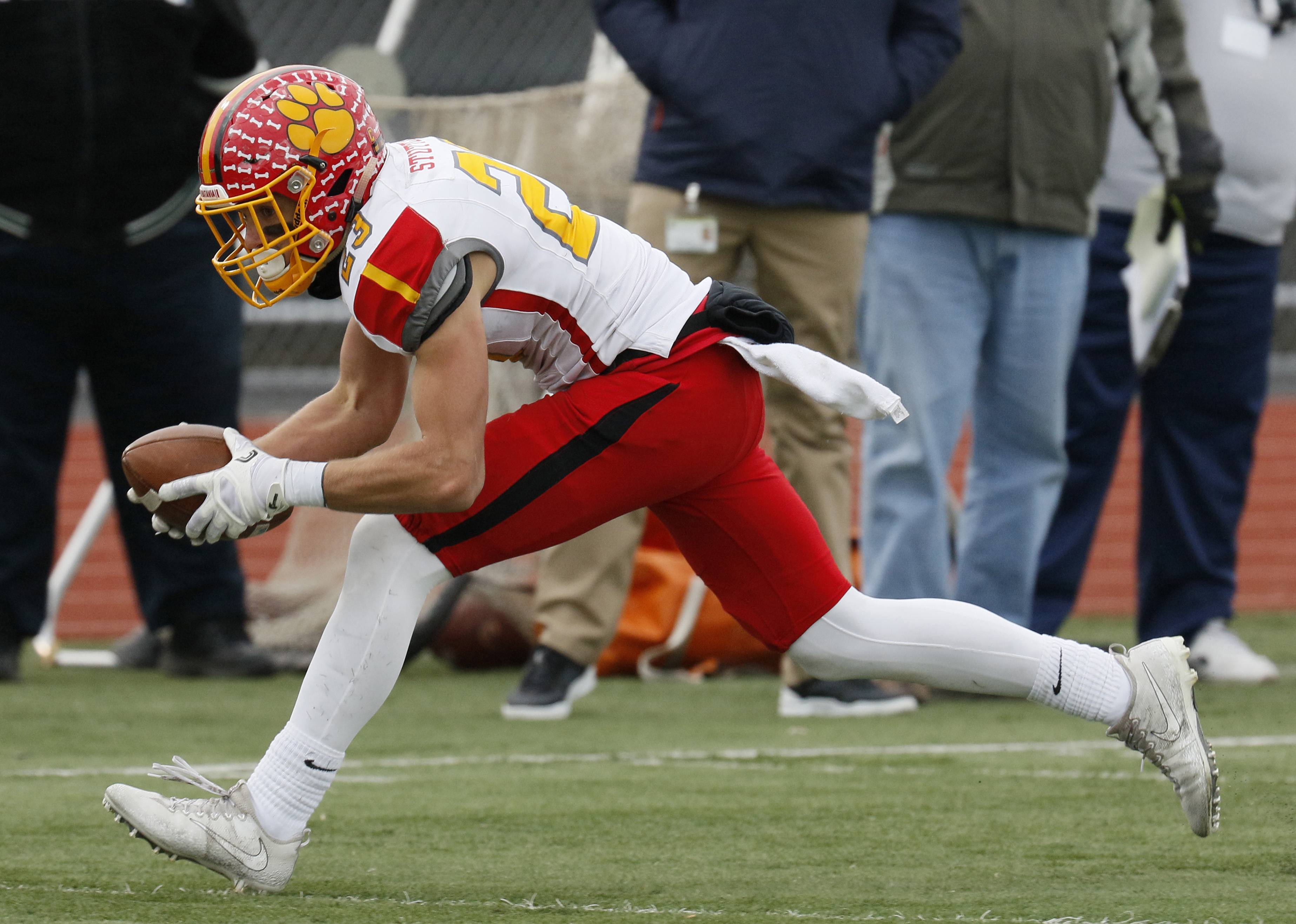 Batavia's Tommy Stuttle catches a second half touchdown pass during a 20-10 win against Lincoln-Way West.