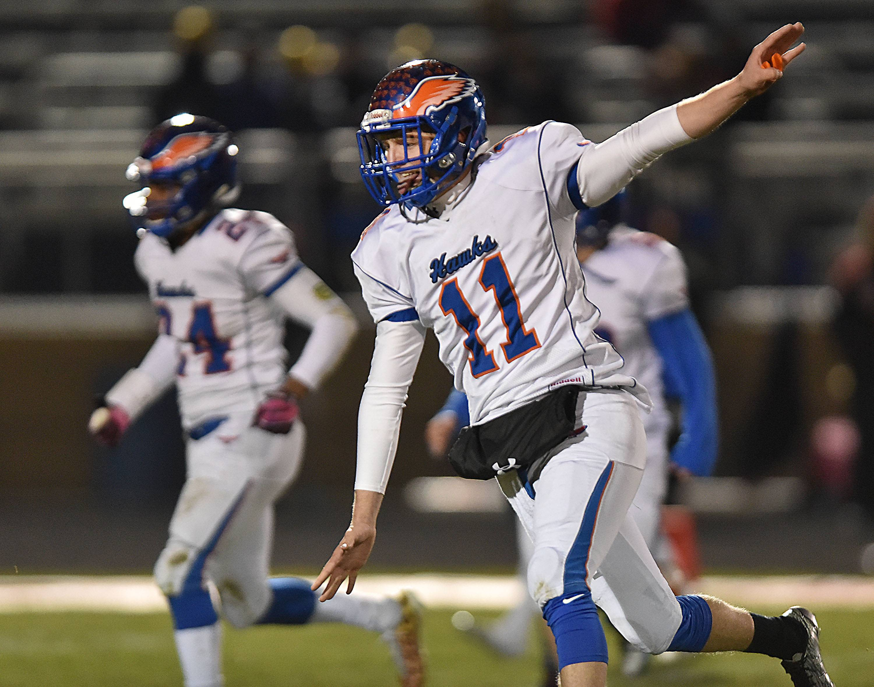 Hoffman Estates quarterback Austin Coalson celebrates the Hawks' win against Belvidere North last Saturday in the state quarterfinal game in Belvidere.