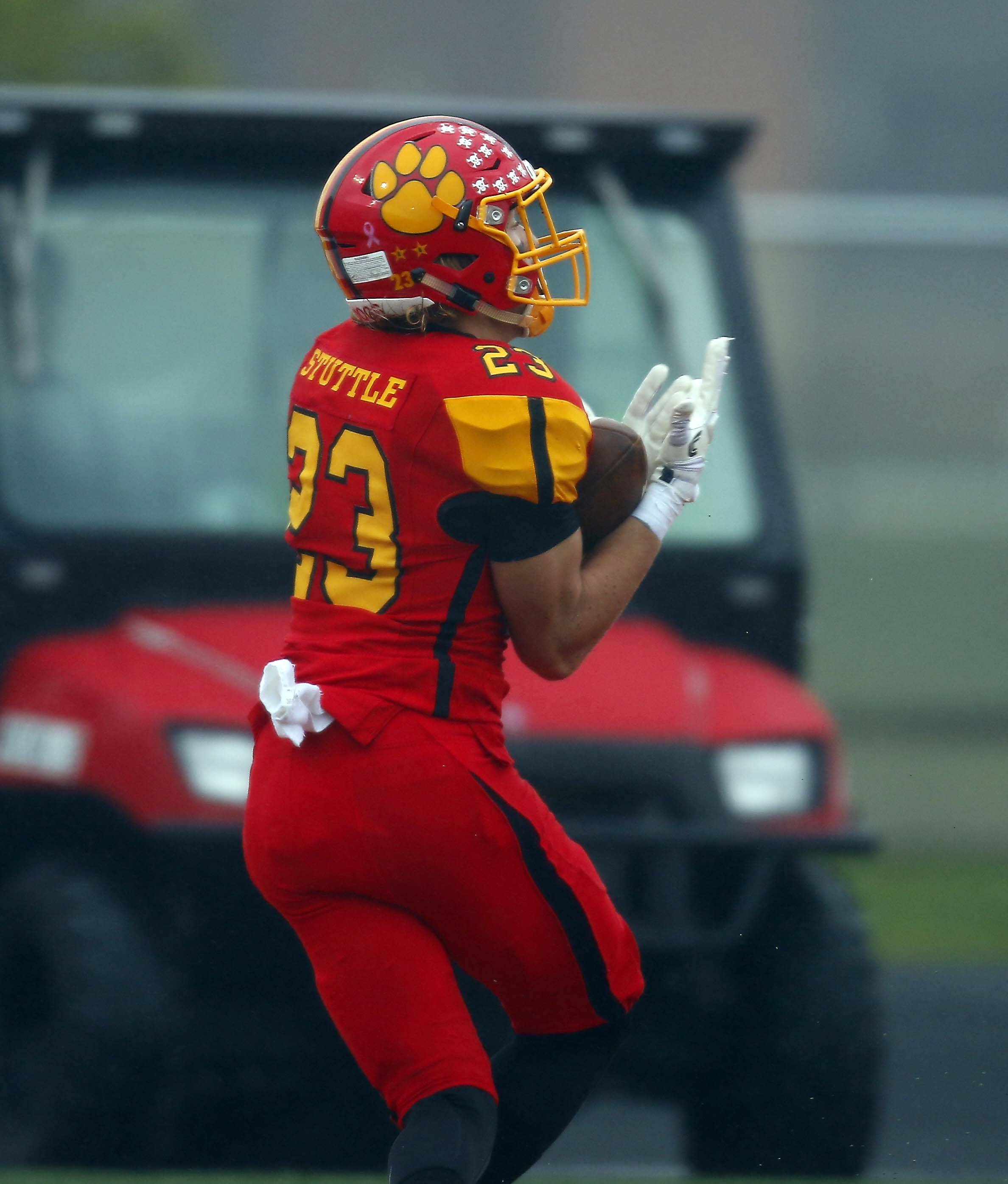 Batavia's Tom Stuttle (23) reels in a touchdown against Wheaton North during the second round of the Class 7A football playoffs in Batavia.