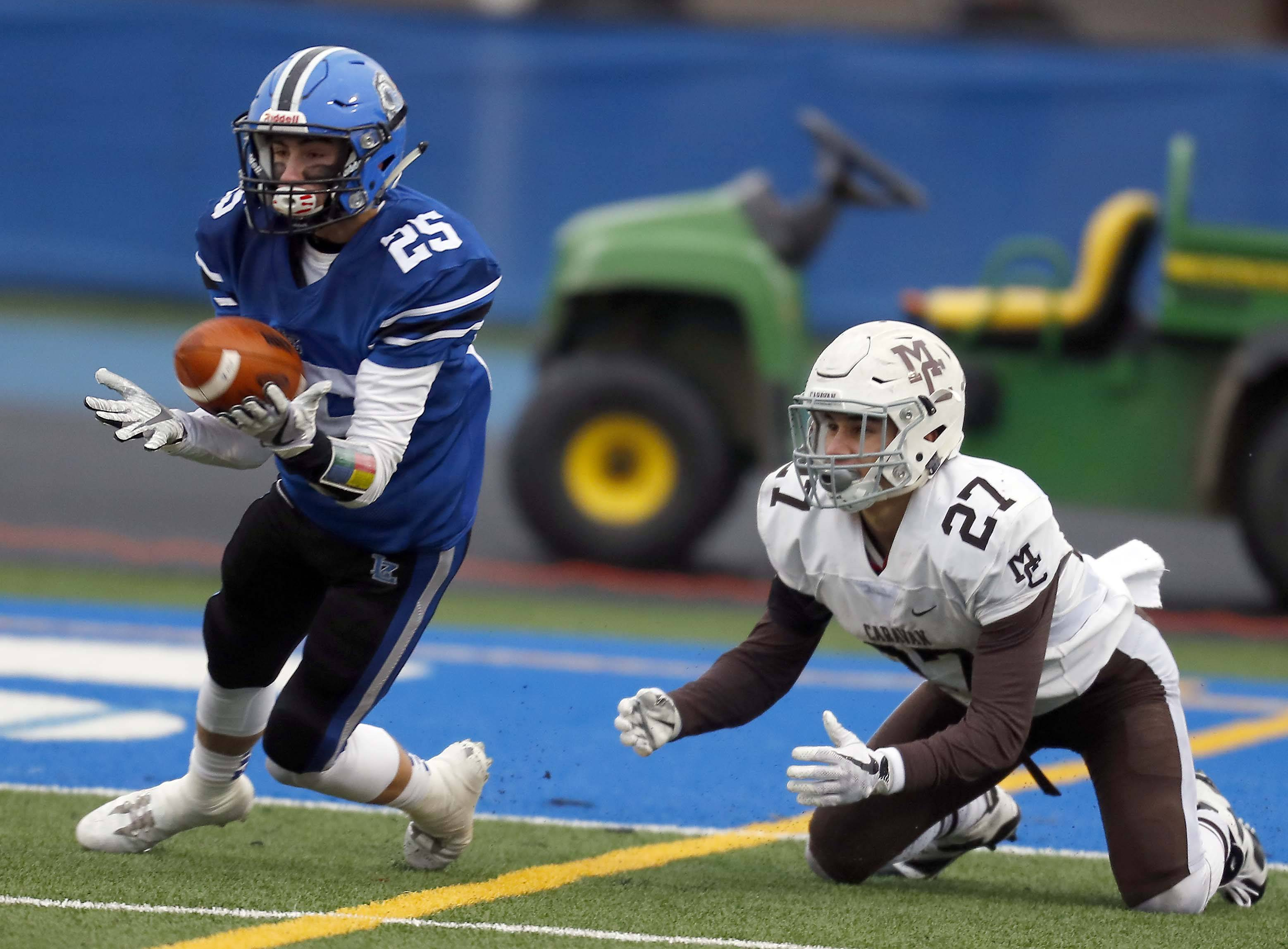 Lake Zurich's Anthony Mangano (25) pulls in a fourth-quarter interception against Mt. Carmel in the Class 7A semifinals Saturday.