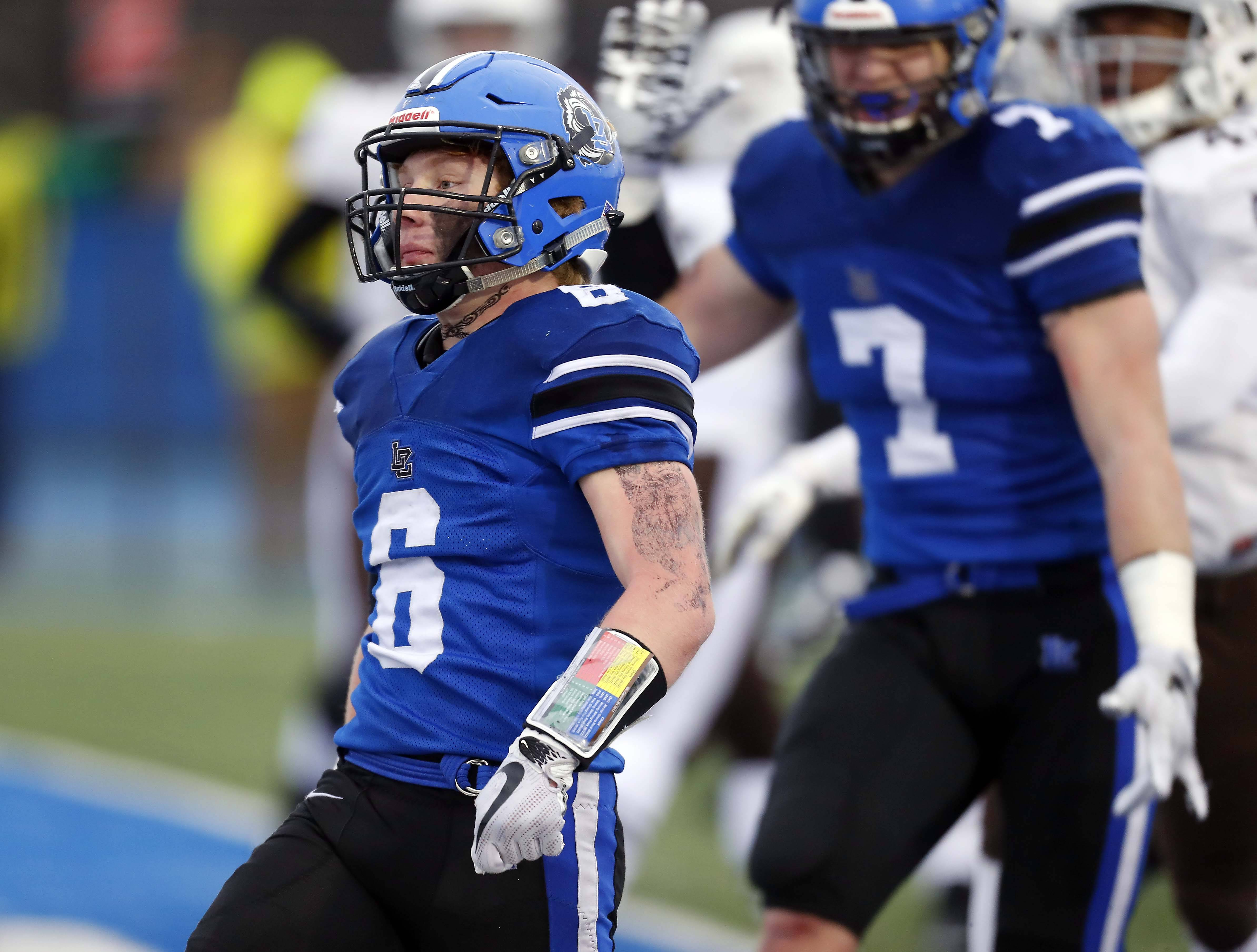 Lake Zurich's Joey Stutzman (6) struts into the end zone for a fourth-quarter touchdown against Mt. Carmel in the Class 7A state semifinals.