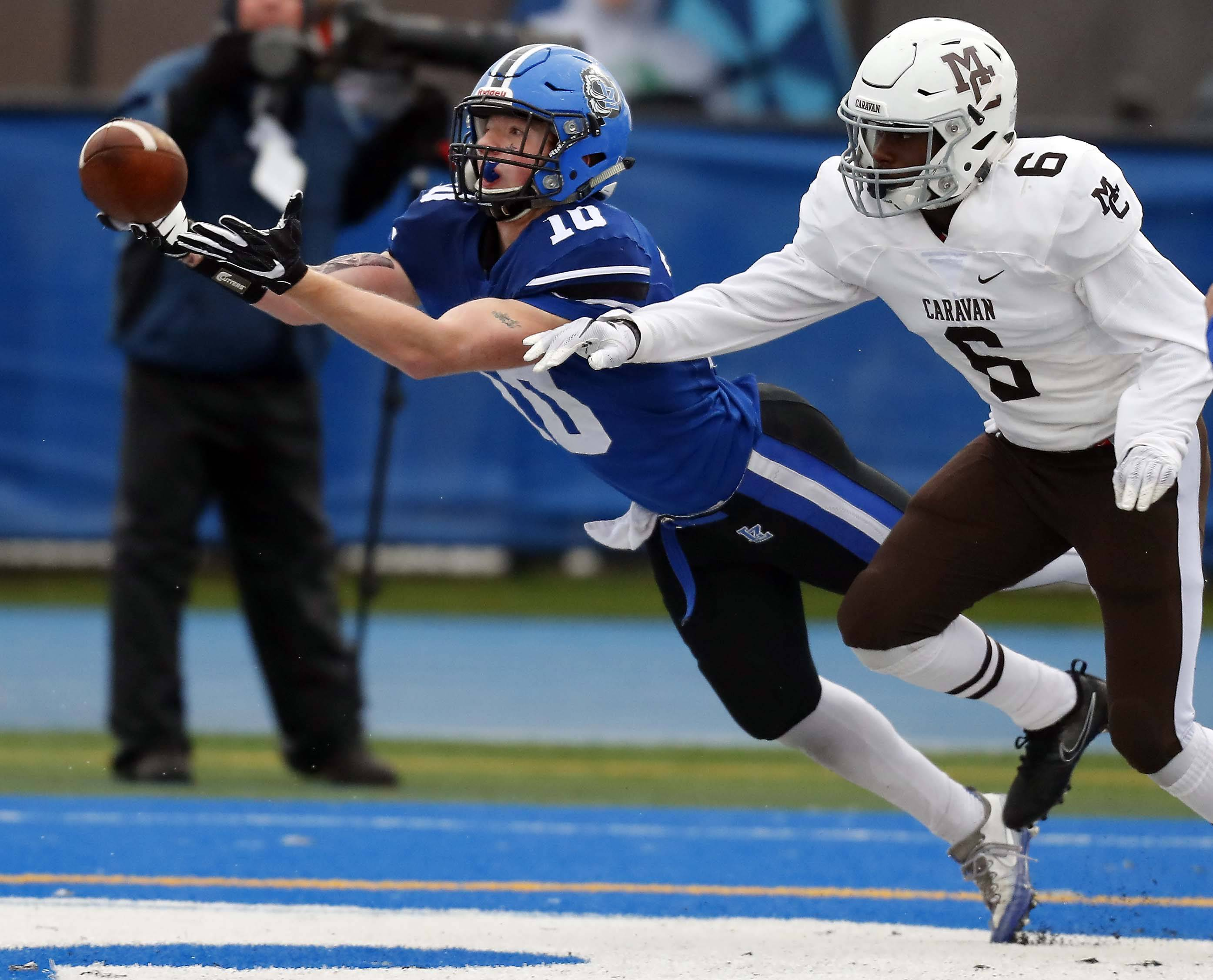 Lake Zurich's Matthijs Enters (10) tries to reel in a pass as Mount Carmel's Connor Lane (6) tries to stop him Saturday during the Class 7A state semifinals.