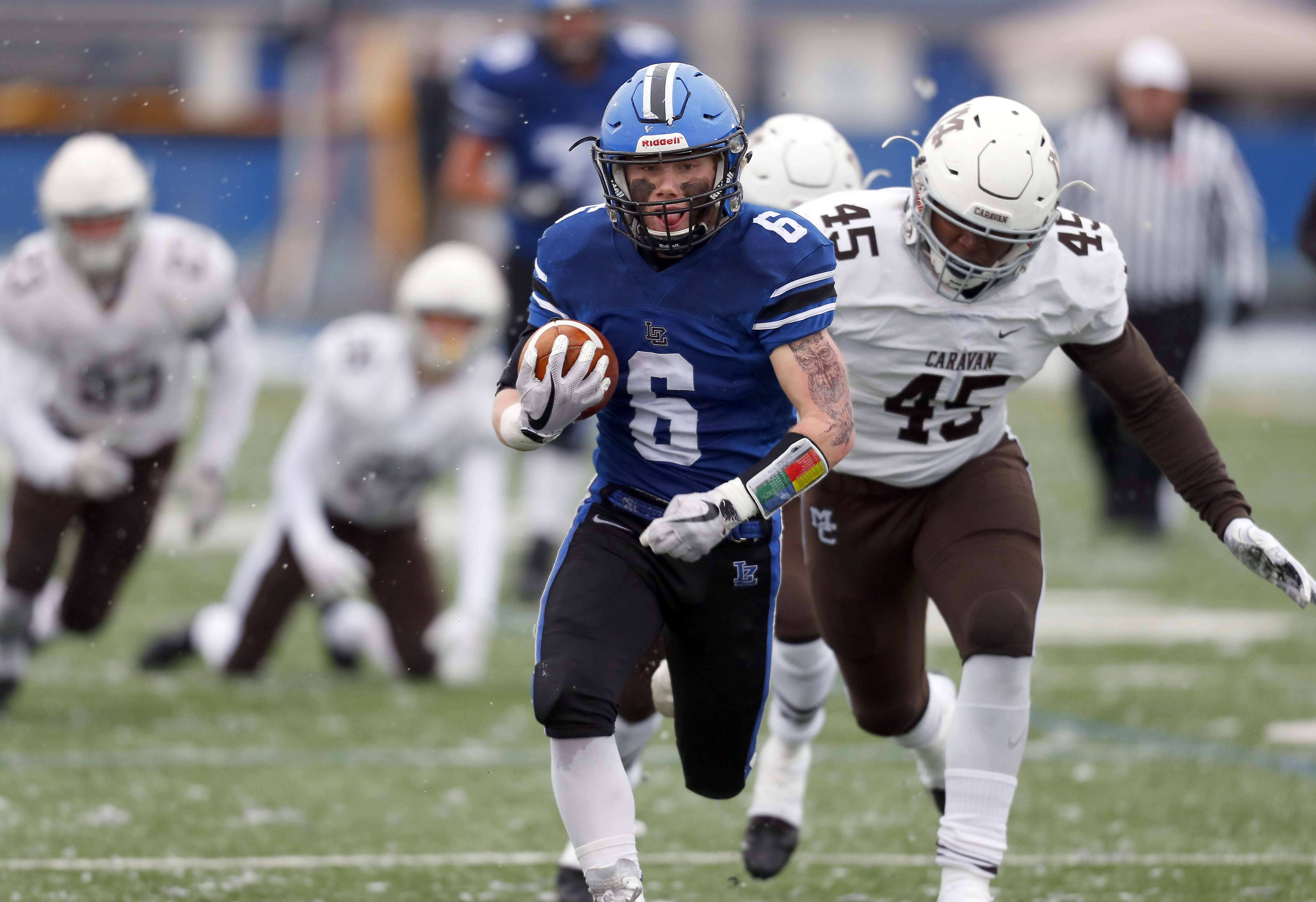 Lake Zurich's Joey Stutzman (6) moves upfield against visiting Mt. Carmel on Saturday during the Class 7A state semifinals.