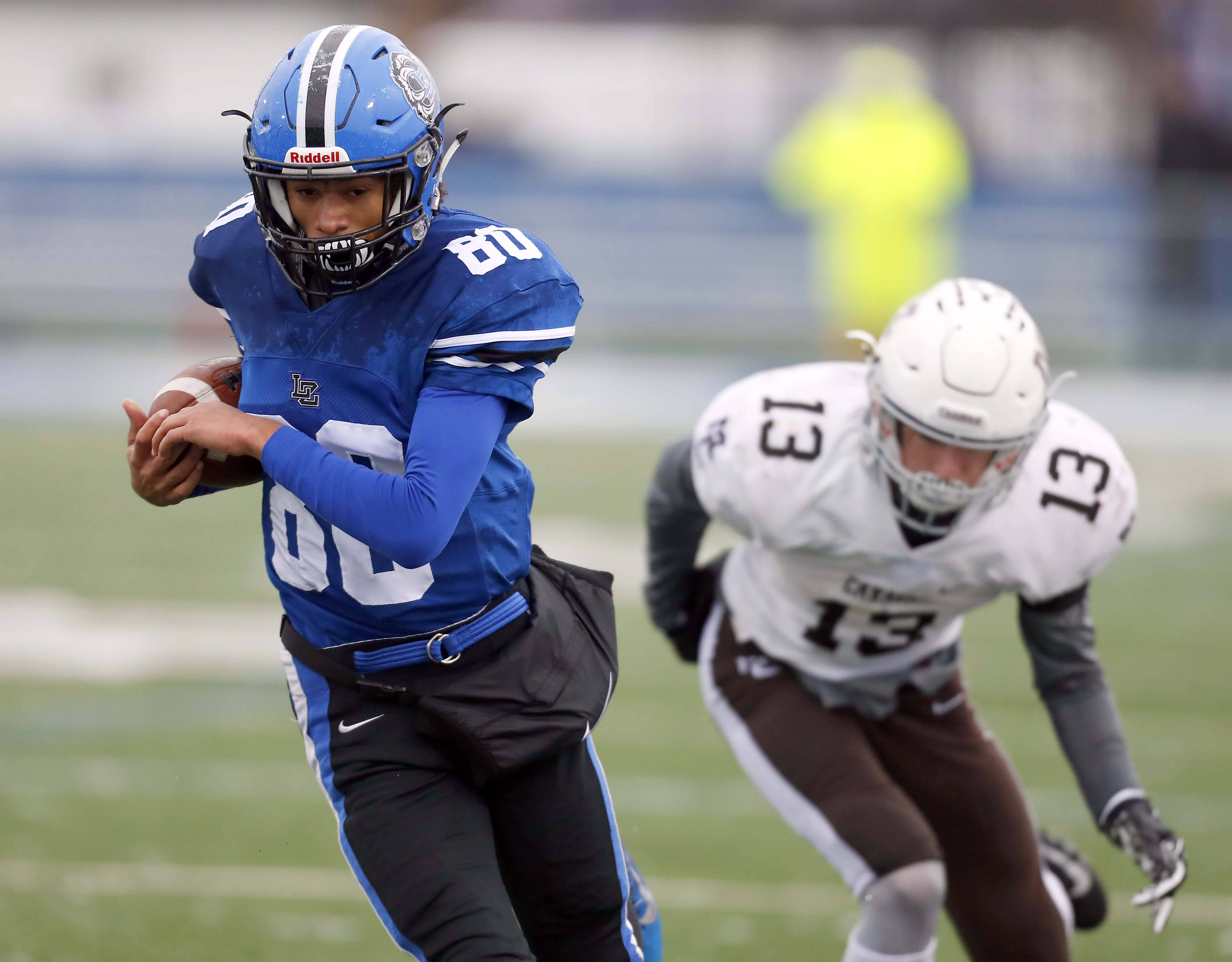 Lake Zurich's Payton Powell (80) goes in for a touchdown early against visiting Mt. Carmel in the Class 7A state semifinals.