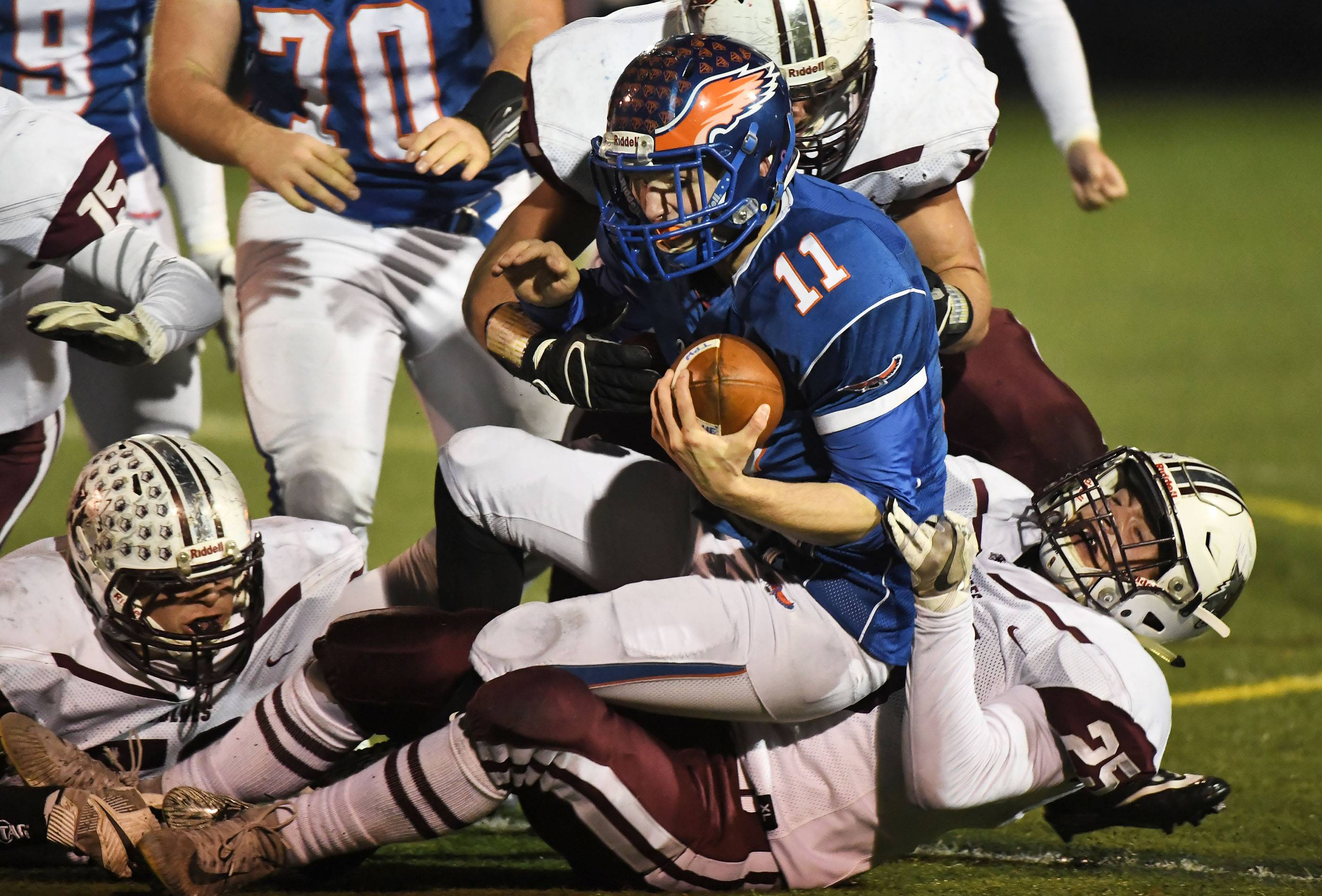 Hoffman Estates' Austin Coalson is sacked by Prairie Ridge's Jacob Ommen late in Saturday's Class 6A semifinal matchup at Hoffman Estates.