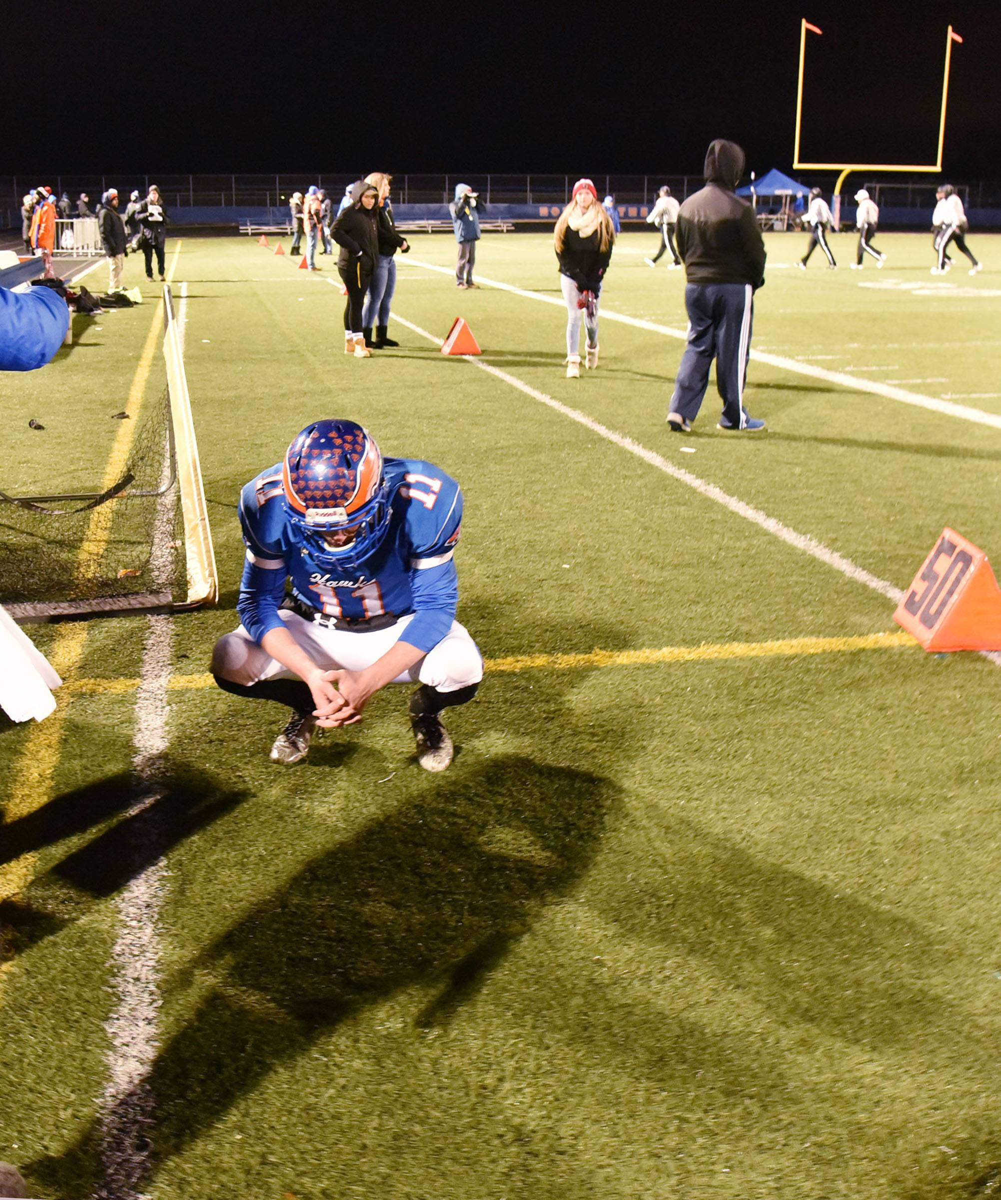 Hoffman Estates' Austin Coalson takes a moment for himself after the Hawks fell short against visiting Prairie Ridge on Saturday in the Class 6A state semifinals.