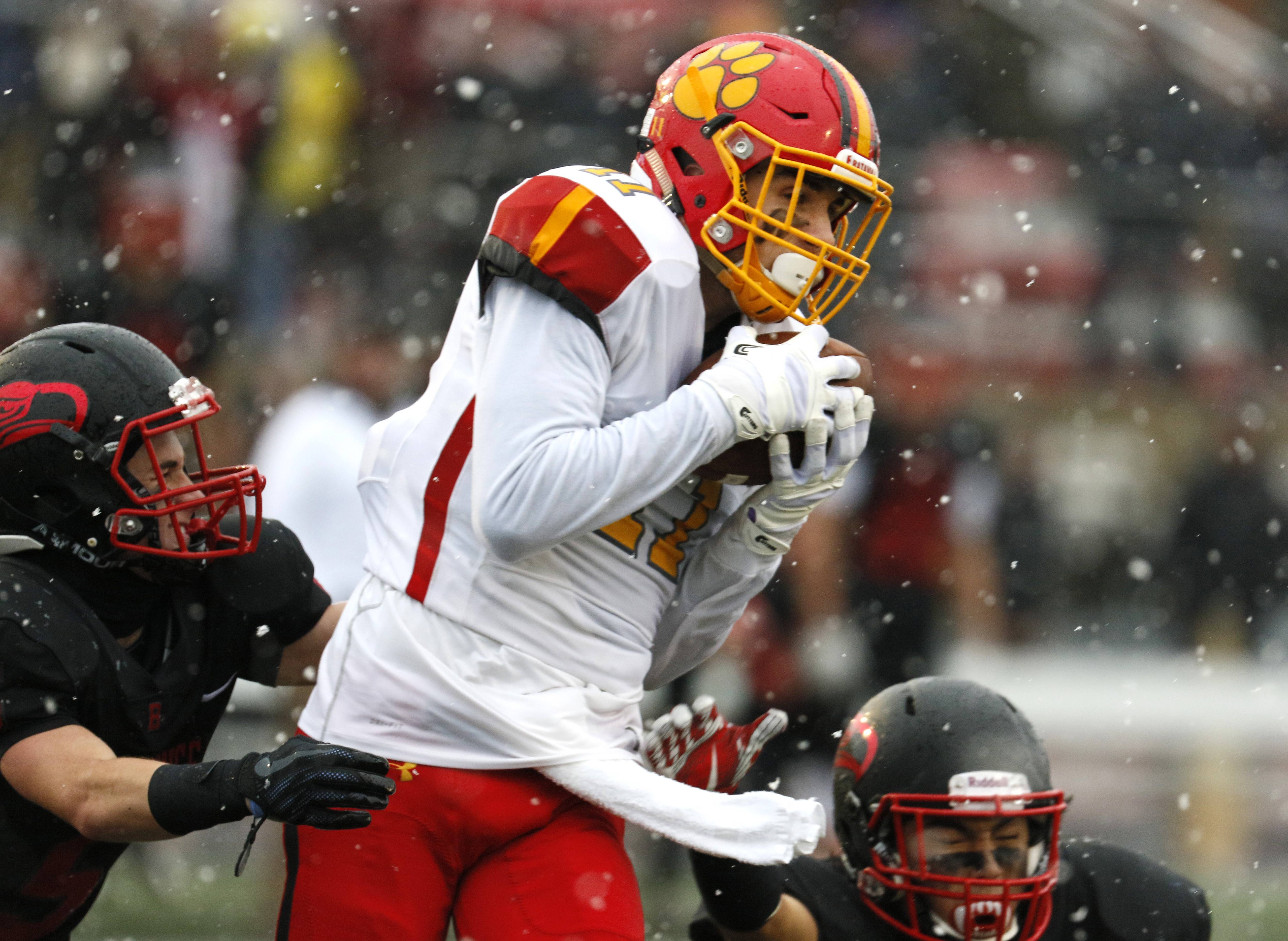 Batavia's Eric Peterson (11) catches a pass against Benet Academy in the Class 7A semifinals in Lisle.