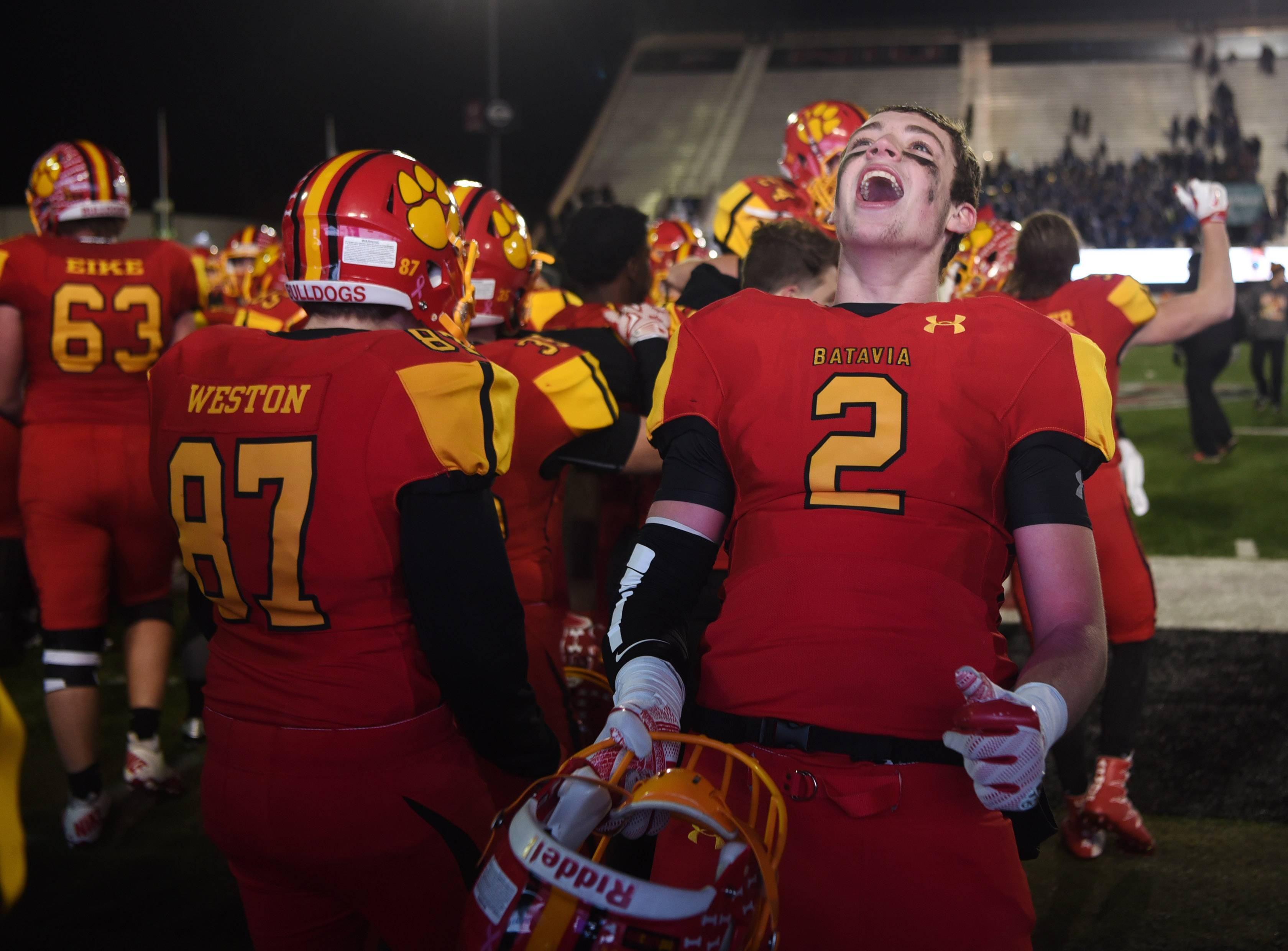 Batavia's Drew Iutzwig celebrates with his teammates following the Bulldogs' 21-14 OT win over Lake Zurich in the Class 7A championship game at Huskie Stadium in DeKalb Saturday.