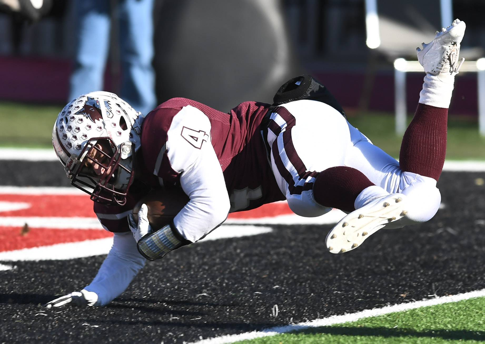 Prairie Ridge's Jackson Willis lands in the end zone for a first-quarter touchdown against Nazareth during the Class 6A championship game at Huskie Stadium in DeKalb Saturday.