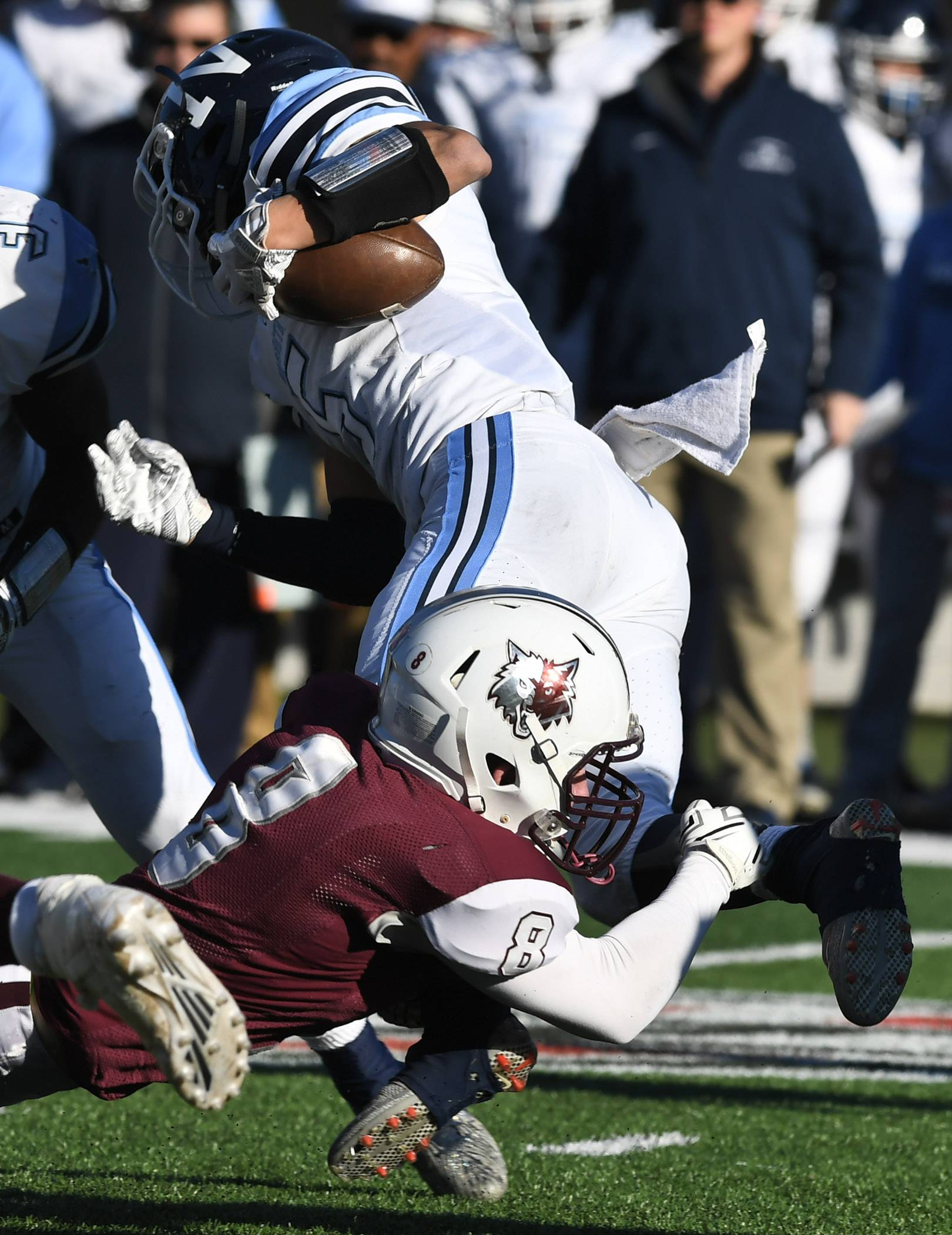 Prairie Ridge's Kyle Koelblinger tackles Nazareth's Alex Carrillo during the Class 6A championship game at Huskie Stadium in DeKalb Saturday.