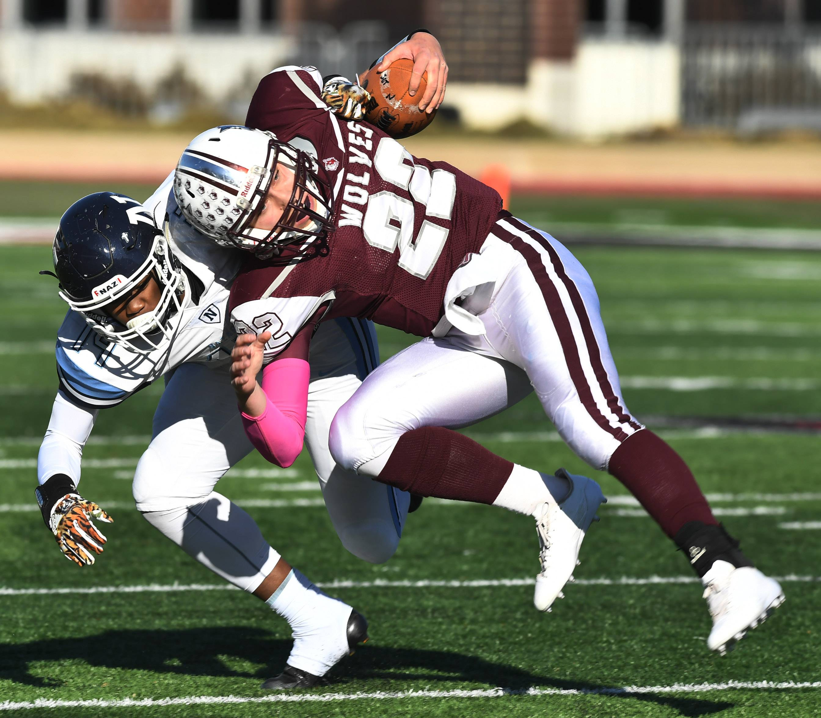 Nazareth's David Oglesby, left, tackles Prairie Ridge's Samson Evans during the Class 6A championship game at Huskie Stadium in DeKalb Saturday.