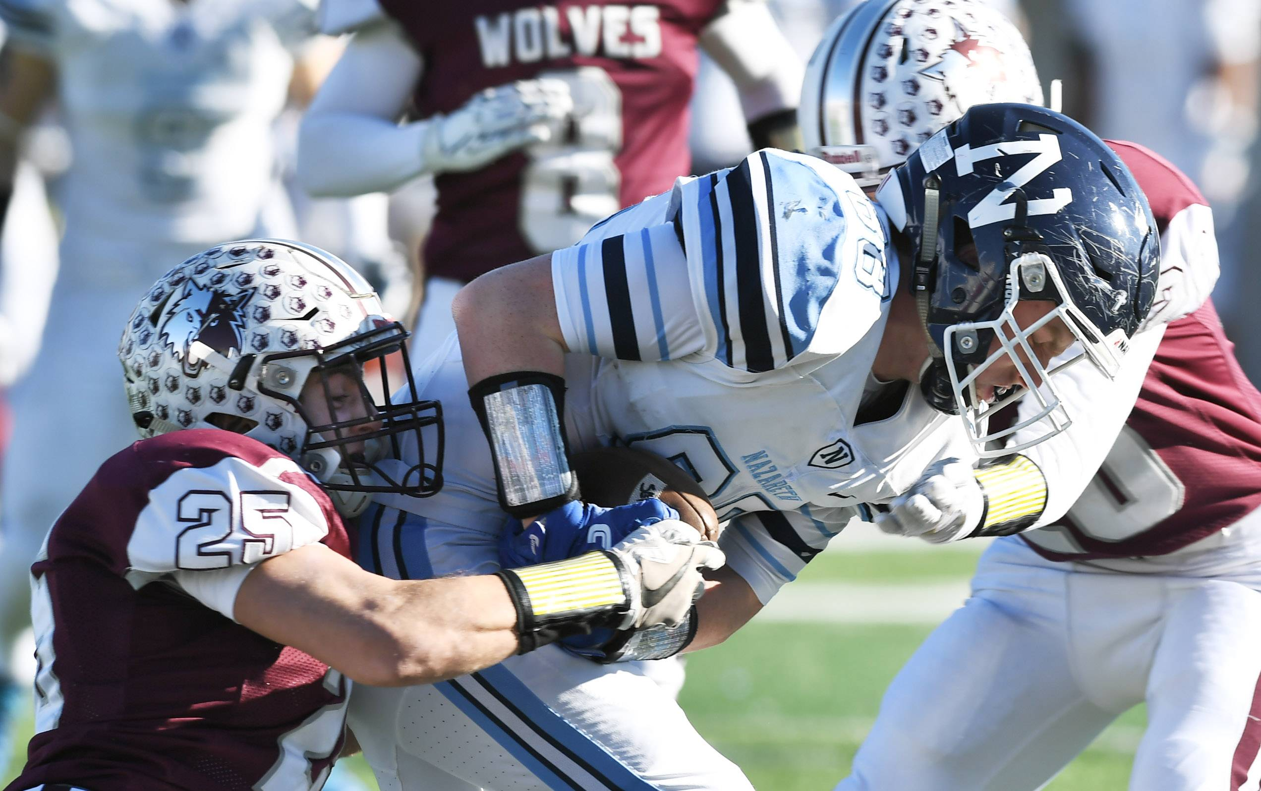 Prairie Ridge's Jacob Ommen, left, and Justin Mikolajczewski tackle Nazareth's Jack Gloor during the Class 6A championship game at Huskie Stadium in DeKalb Saturday.