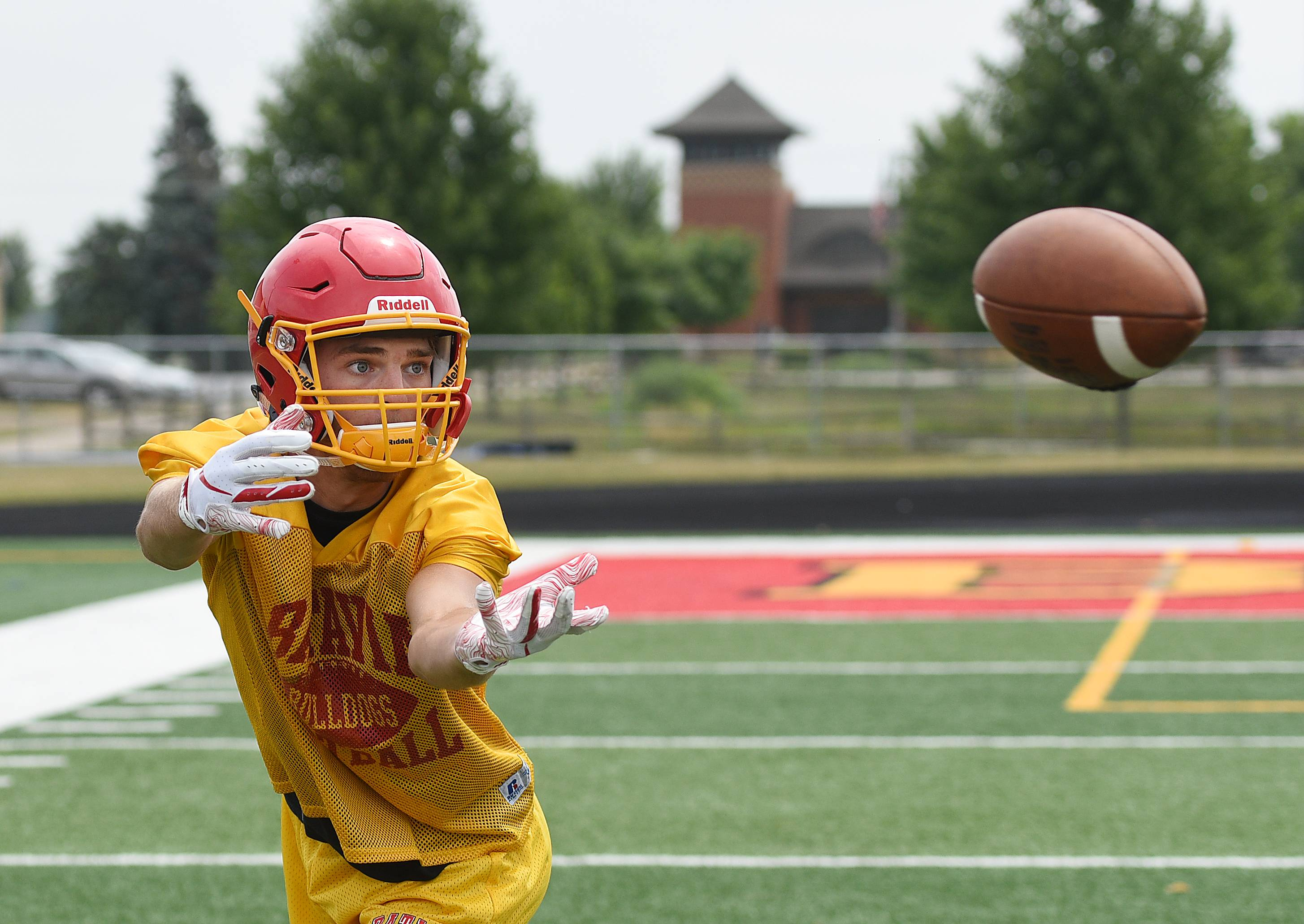 Senior Michael McFarland hauls in a pass during the first day of football practice at Batavia High School Monday.