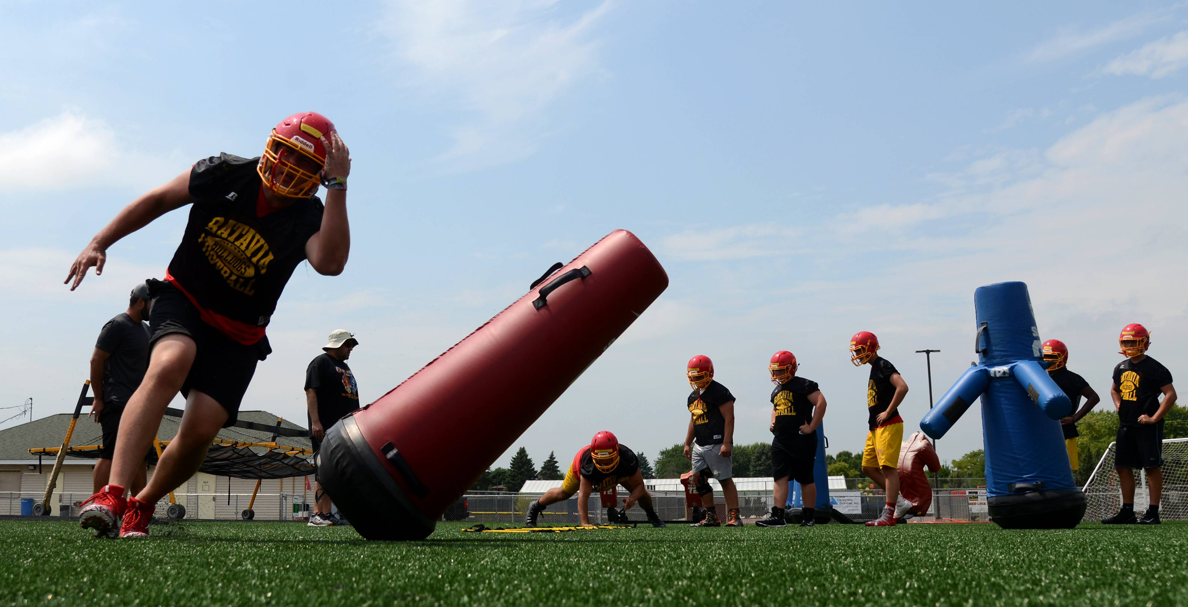 Senior McKinley Neville and the defending state champion Batavia Bulldogs football team took the field Monday for the first day of football practice at Batavia High School.