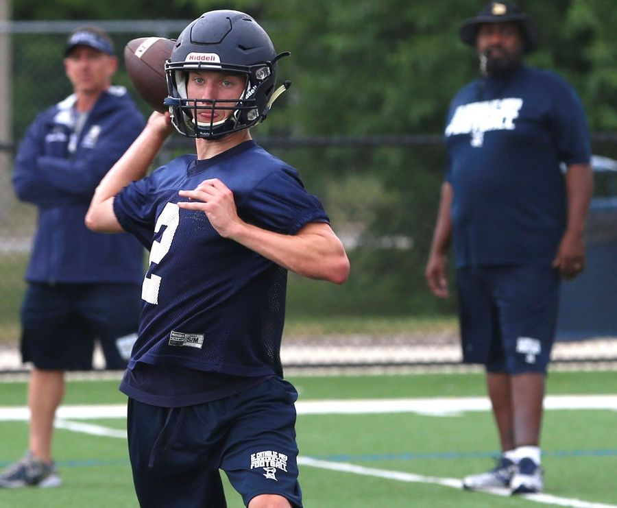 The Knights of IC Catholic Prep practiced on Monday at Lewis Stadium on the Plunkett Athletic Complex in Elmhurst. Tommy Ryan looks for an open receiver.