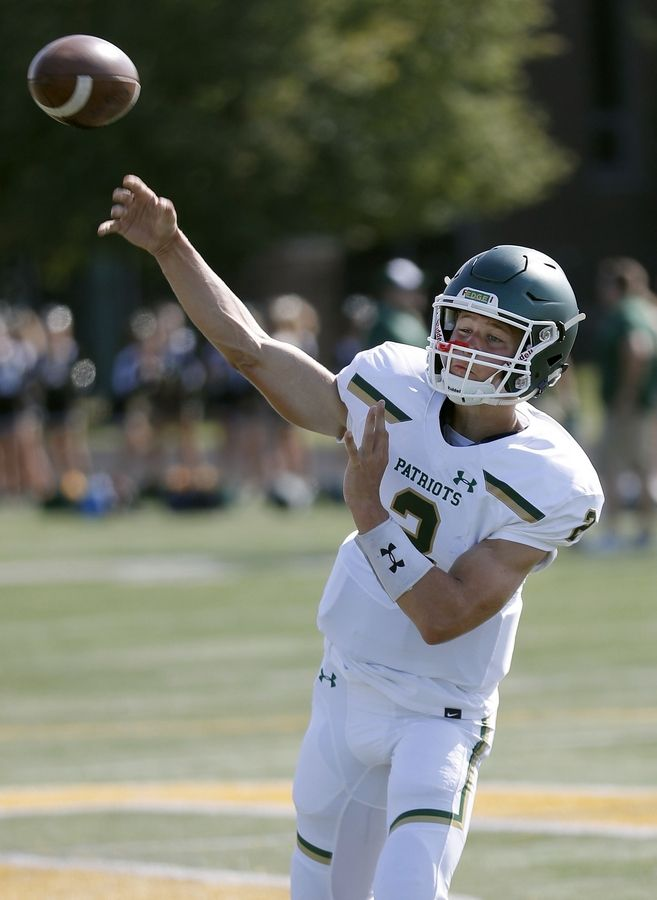 QB Cole Okmin throws during football practice Friday at Stevenson High School in Lincolnshire.