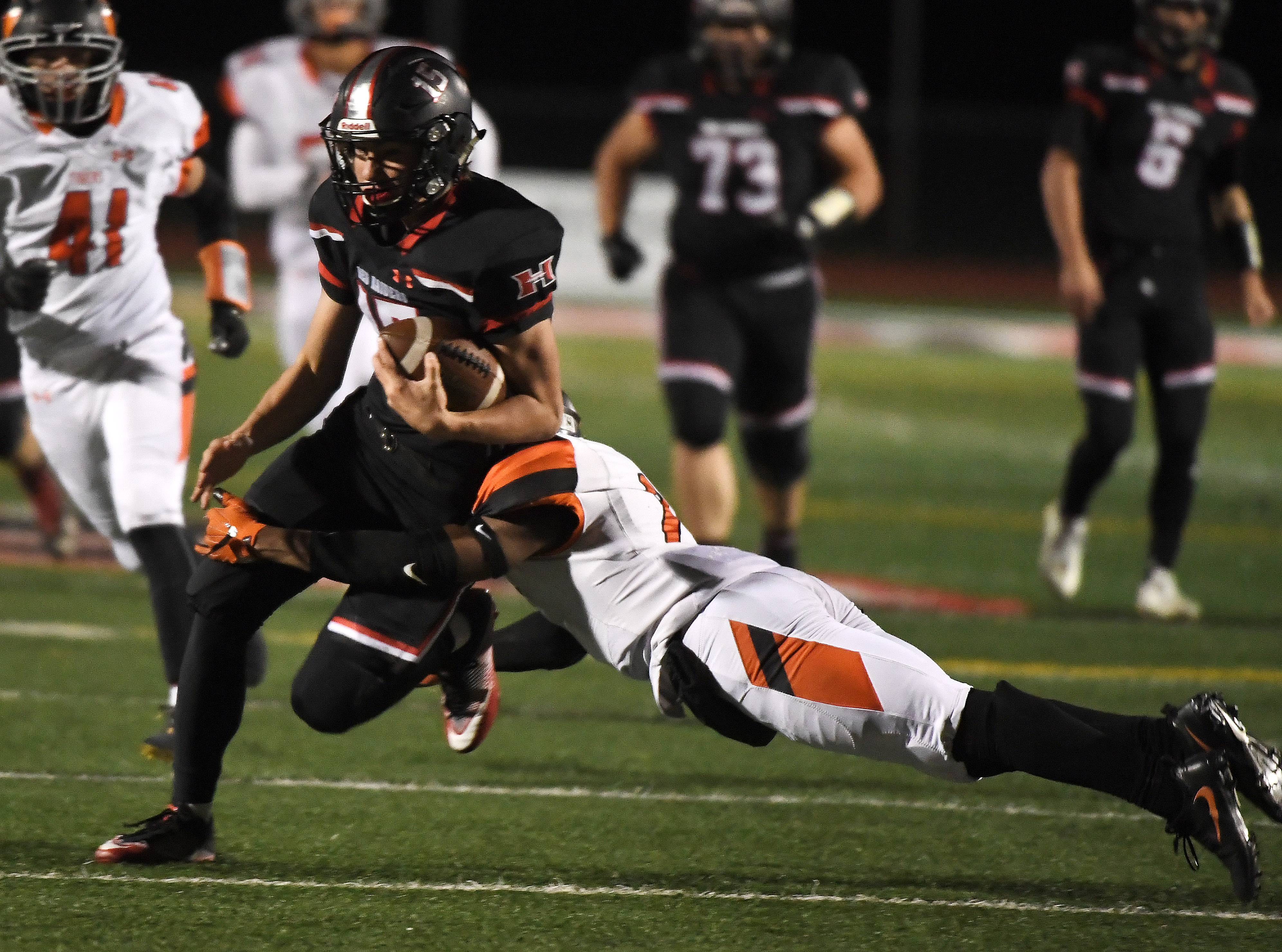 Huntley's Michael Boland (15) picks up some yards after the catch during first-round playoff action last season. Boland returns for the Red Raiders this season.