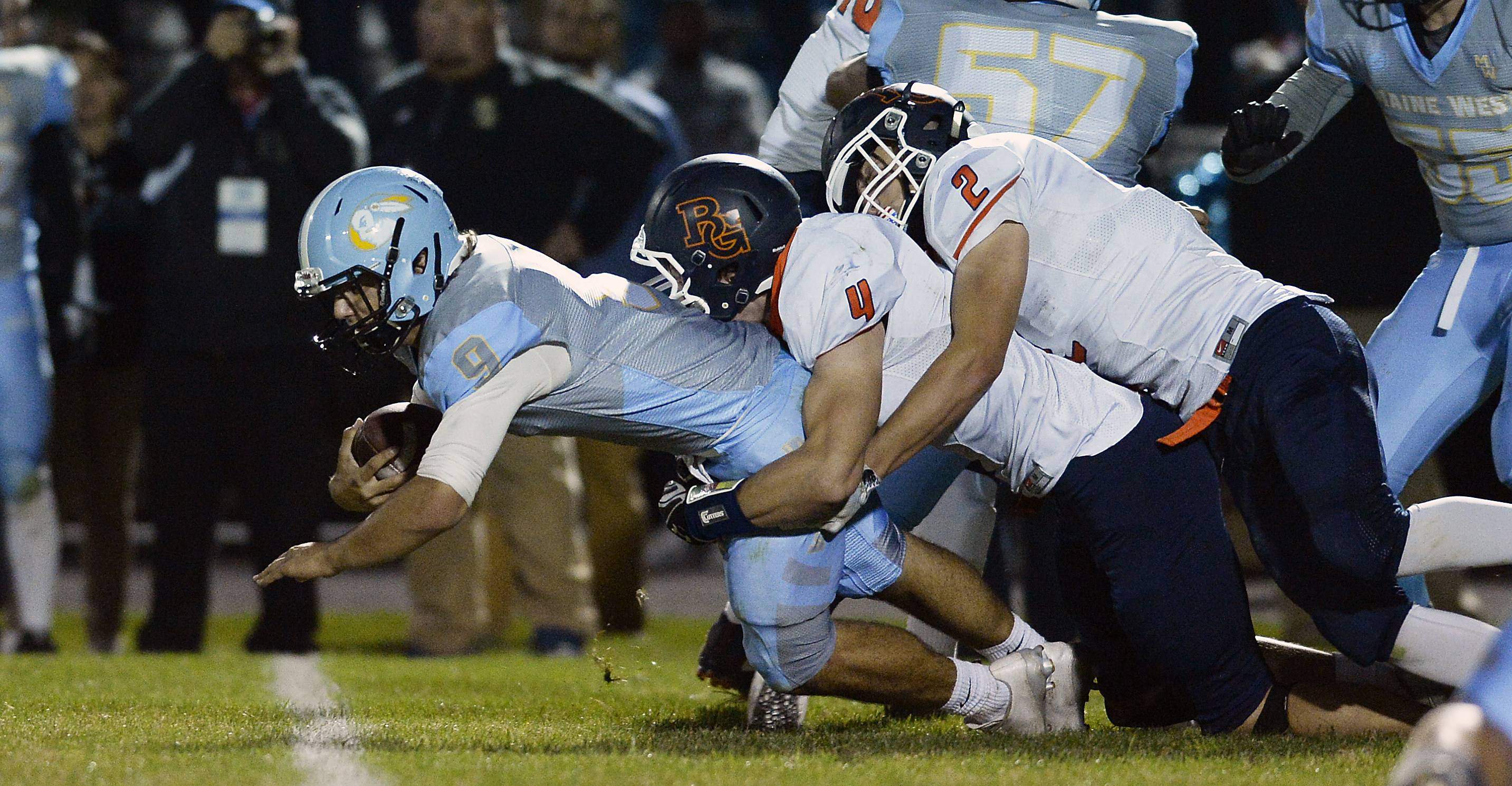 Buffalo Grove's Justin Gold and Tom Trieb bring down Maine West's George Markakis last season. The hard-hitting Trieb, bound for NIU, helps lead the way for the Bison at linebacker and running back this year.