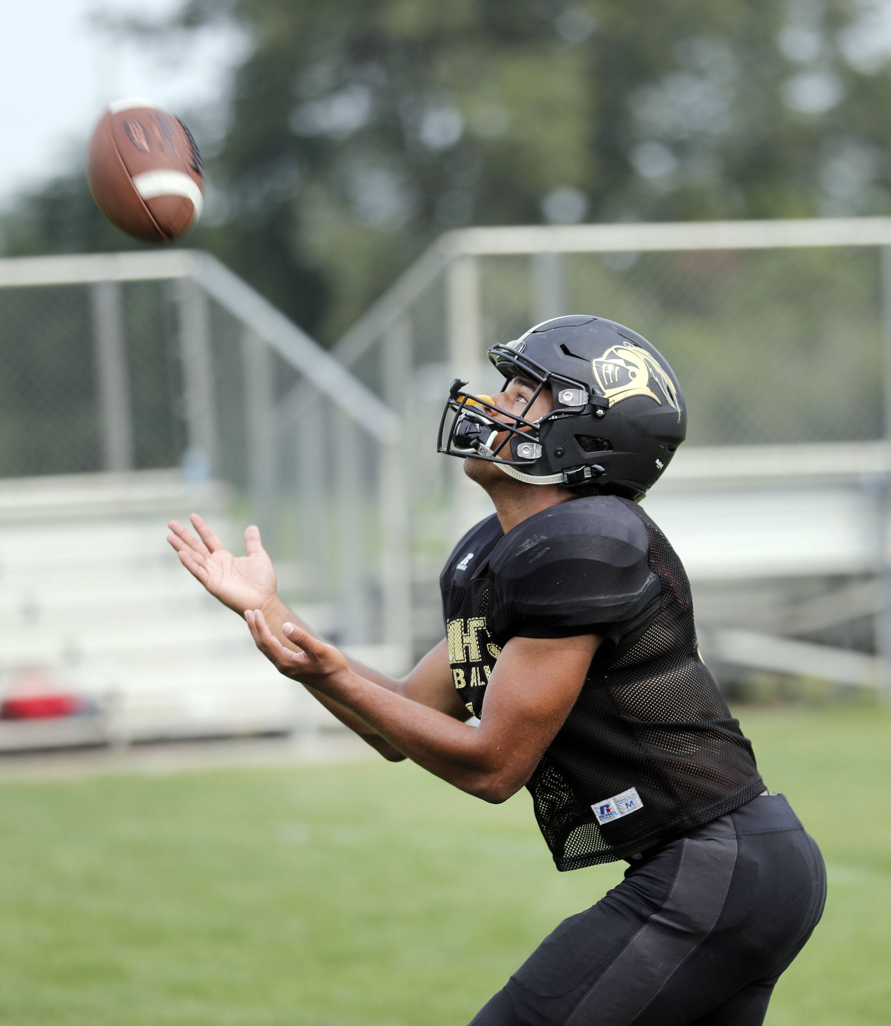 RB Jordan Curtis catches a punt during football practice at Grayslake North.