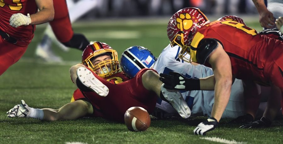 Batavia's Michael Jansey, left, watches the ball pop loose following his tackle of Lake Zurich's Jack Moses during the Class 7A championship game at Huskie Stadium in DeKalb last season. Jansey returns for the defending champs this season.