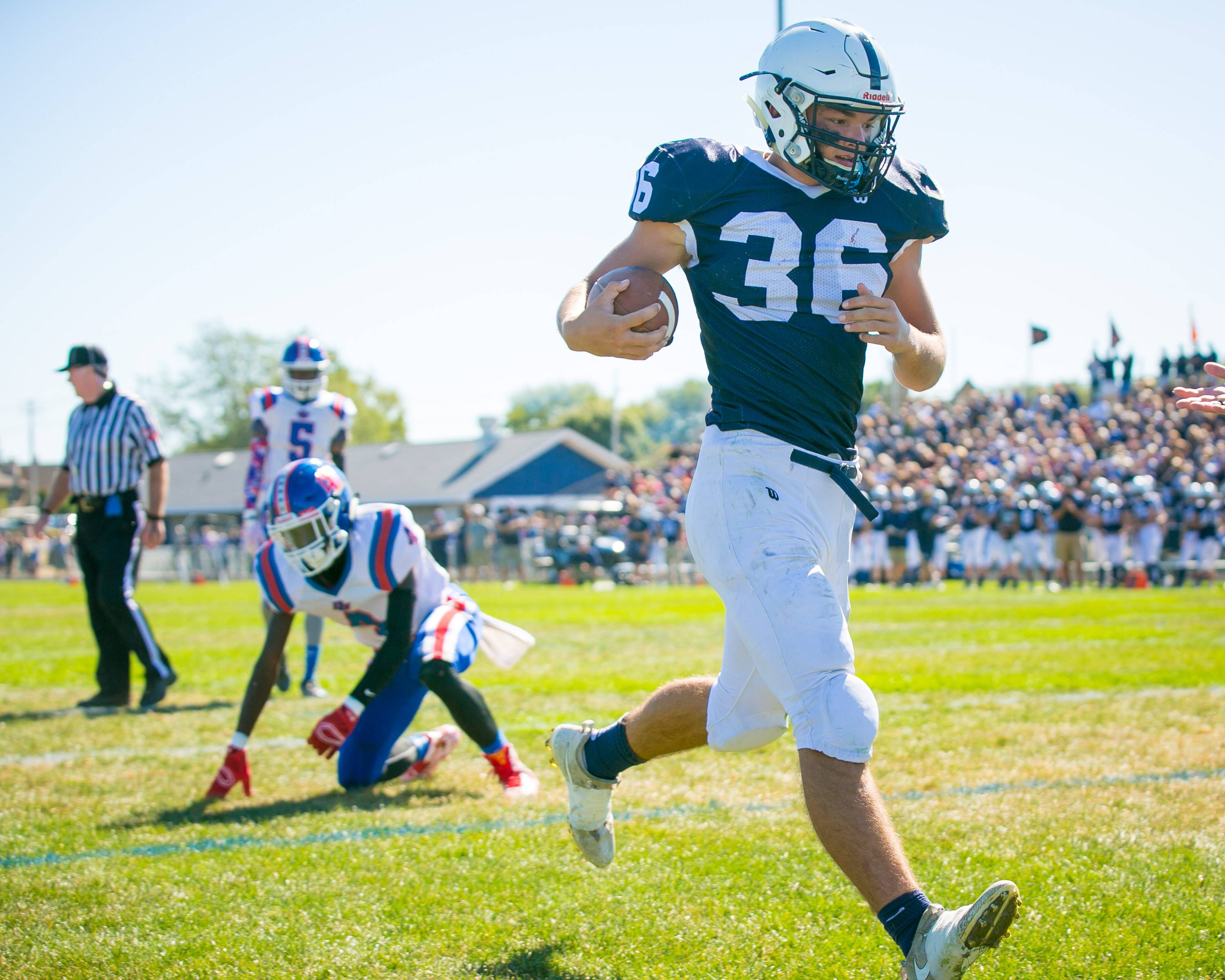 Cary-Grove's Max Buss is one of many talented returning players in the Trojans' backfield this season.