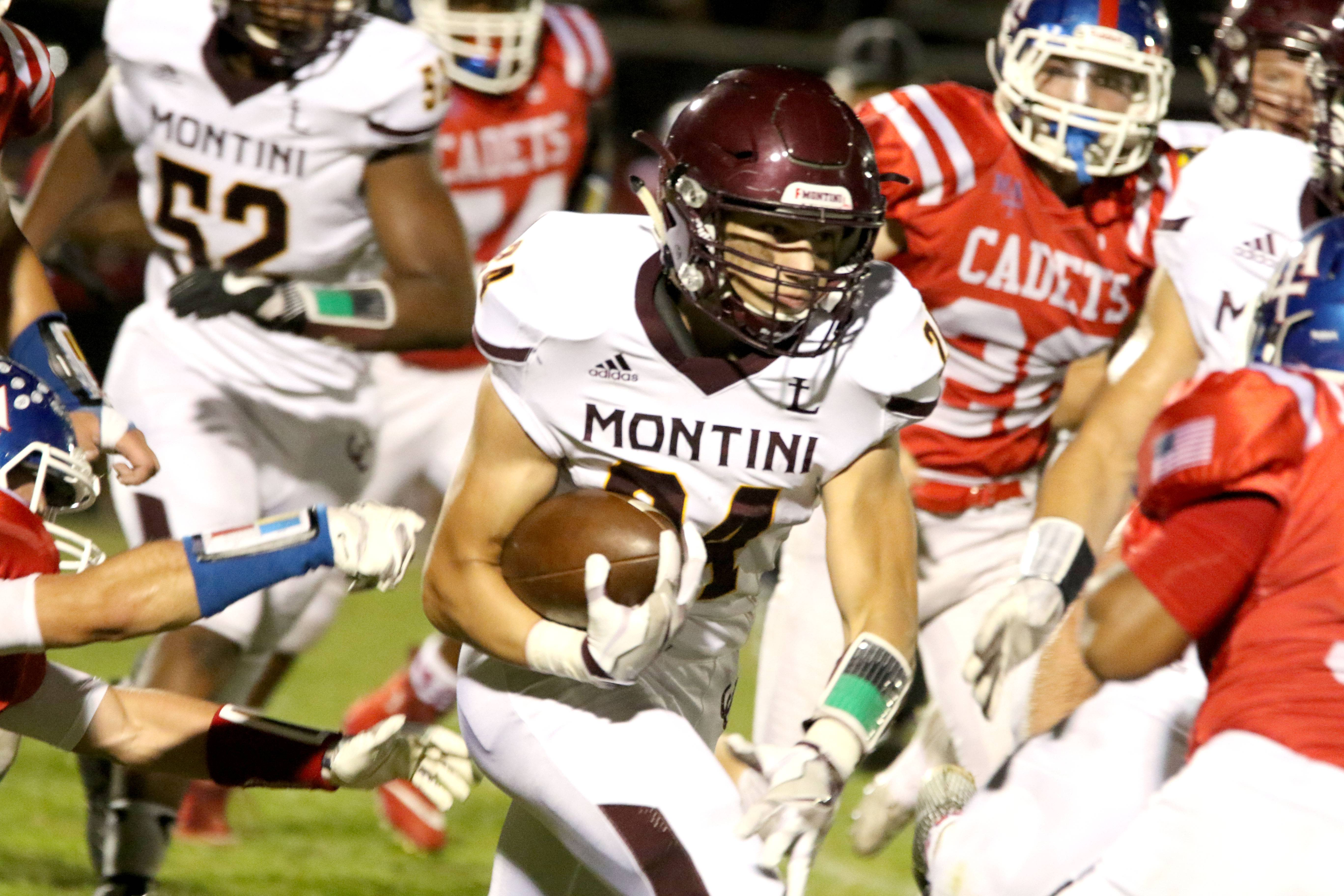 Montini's Nicholas Fedanzo runs the ball during varsity football at Fichtel Field on the campus of Marmion Academy in Aurora Friday night.