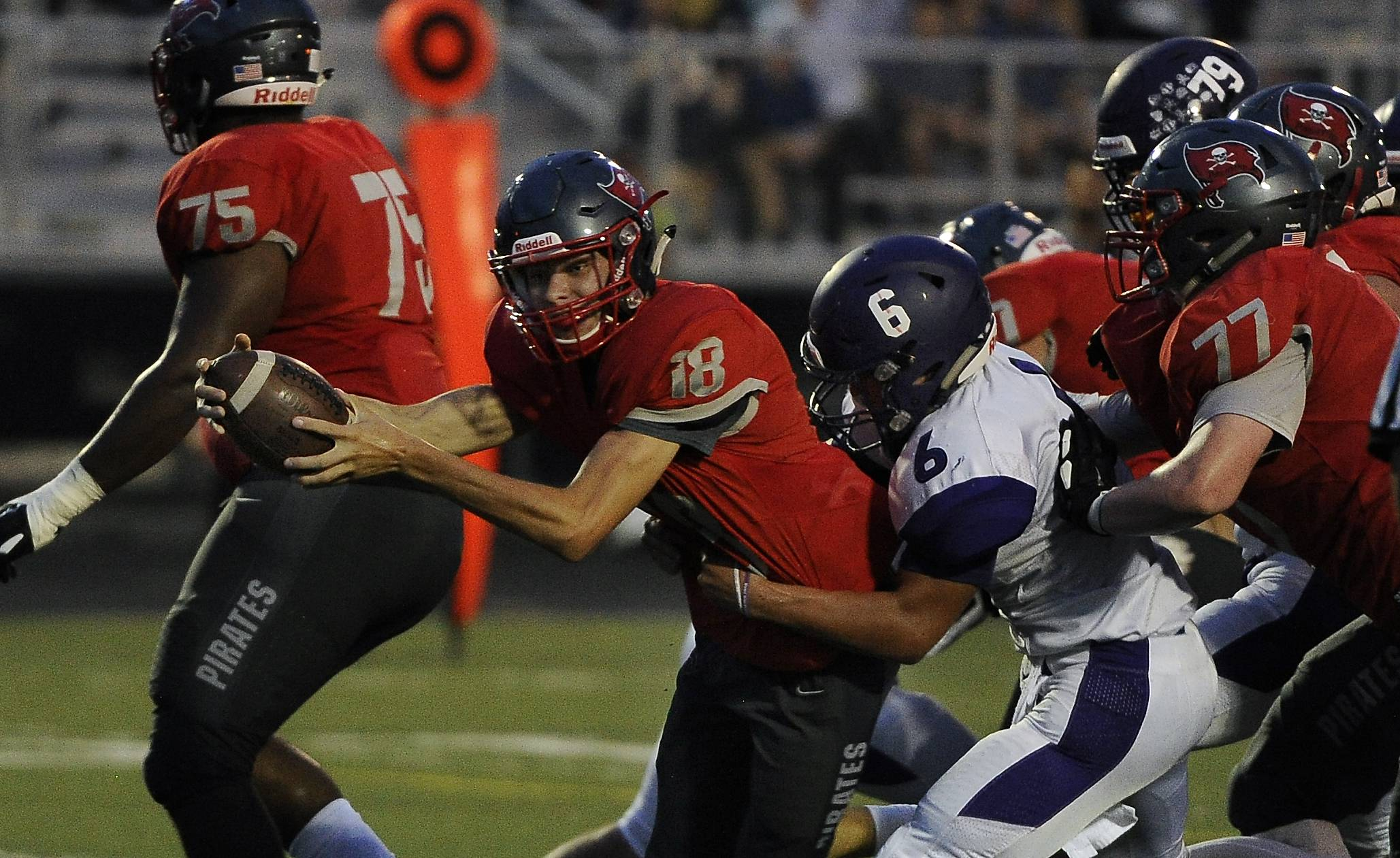 Palatine quarterback Zac Garnmeister reaches across the goal line for the touchdown despite pressure from Rolling Meadows' Jordan Wiles in first quarter Friday at Palatine.